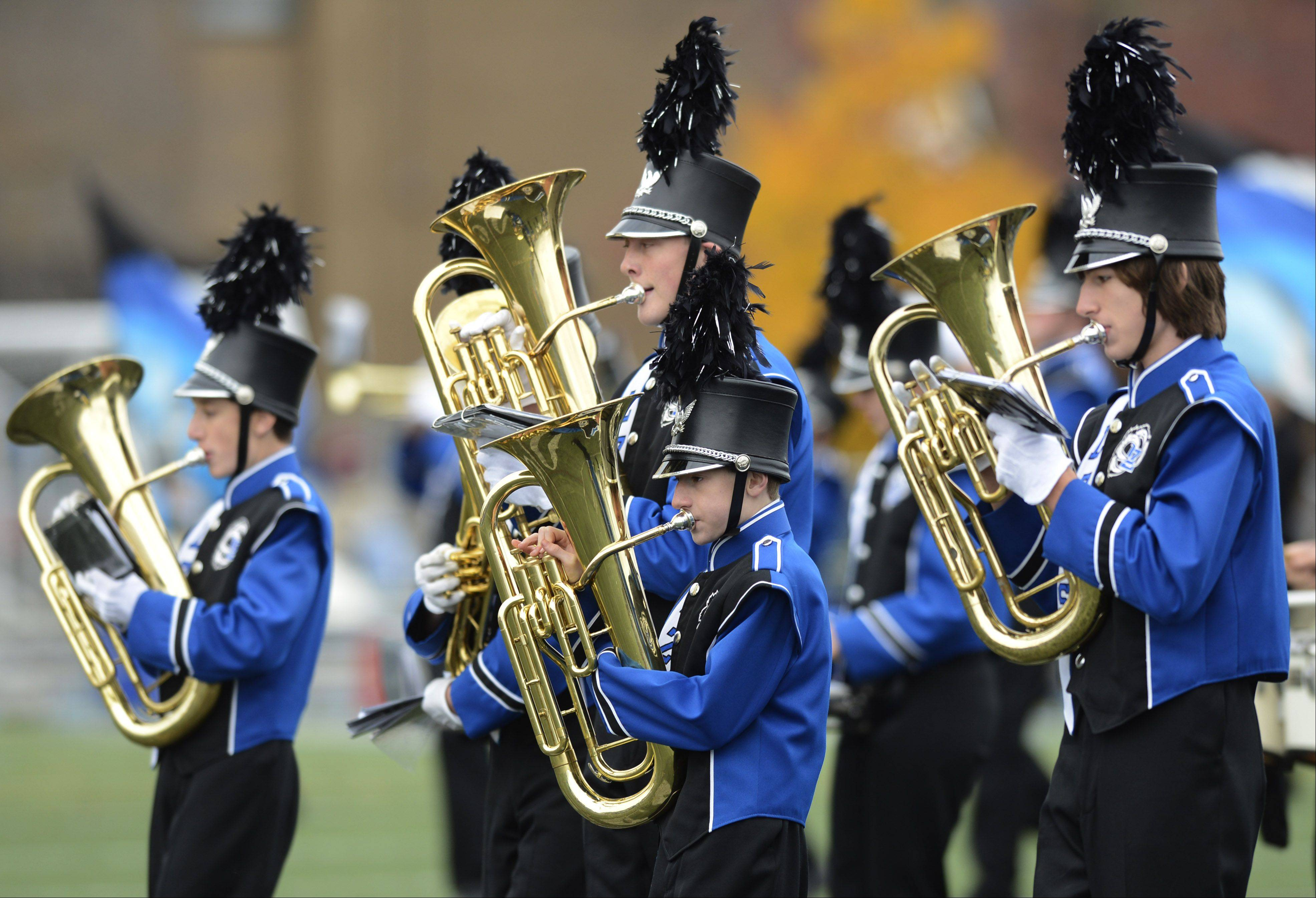 JOE LEWNARD/jlewnard@dailyherald.com  Lake Zurich High School's band performed in a November home football game. Band members and chaperones whose return home from a performance in Madrid, Spain was delayed by weather are on the final leg of their journey.