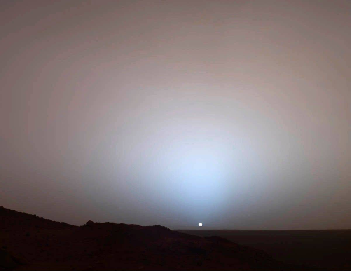 ASSOCIATED PRESSThis image provided by NASA shows a view by the Mars Rover Spirit of a sunset over the rim of Gusev Crater, about 50 miles away. Taken from Husband Hill, it looks much like a sunset on Earth, a reminder that other worlds can seem eerily familiar.