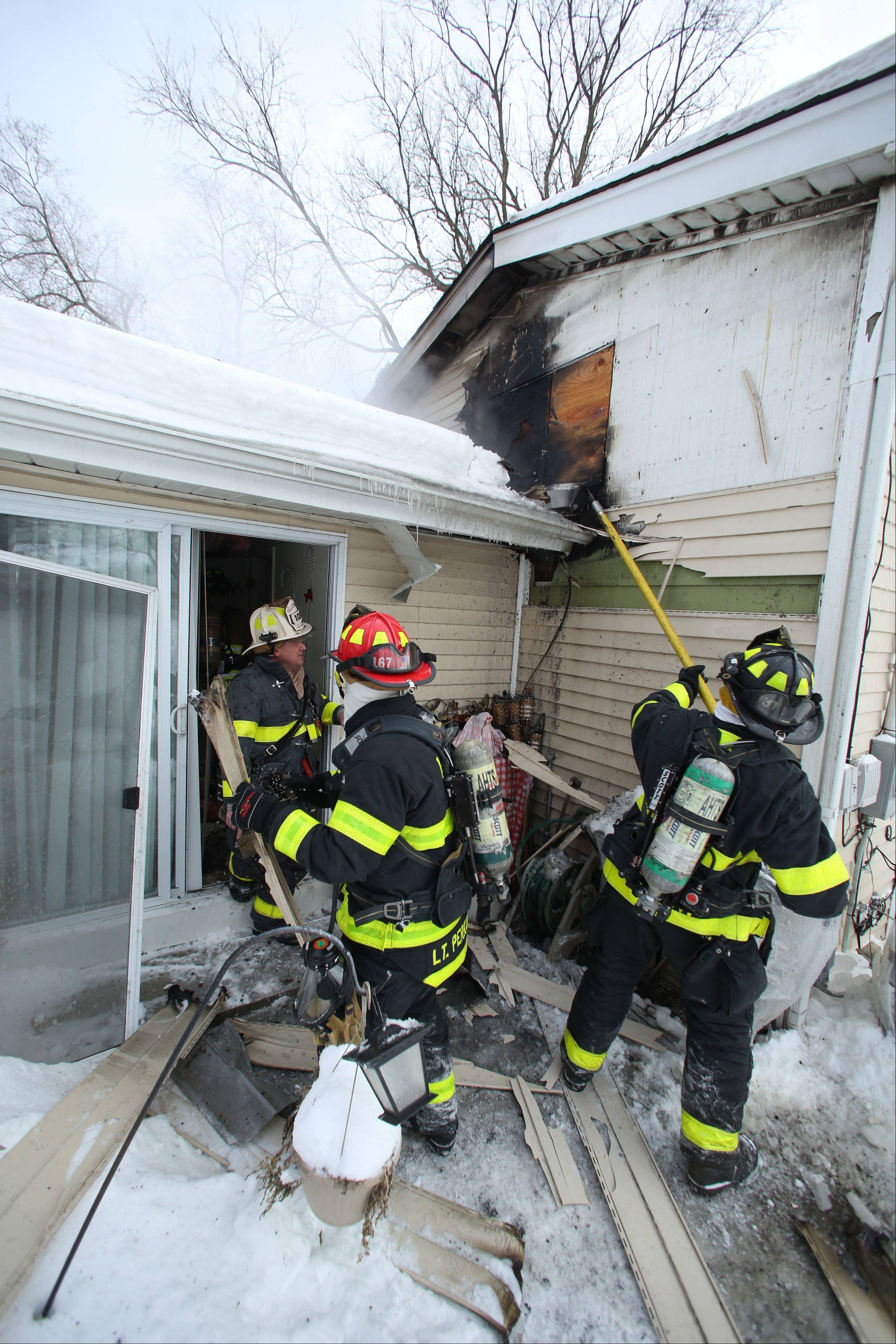 Arlington Heights firefighters on Tuesday afternoon attacked a fire from the rear porch of a home on the 1600 block of Yale Avenue.
