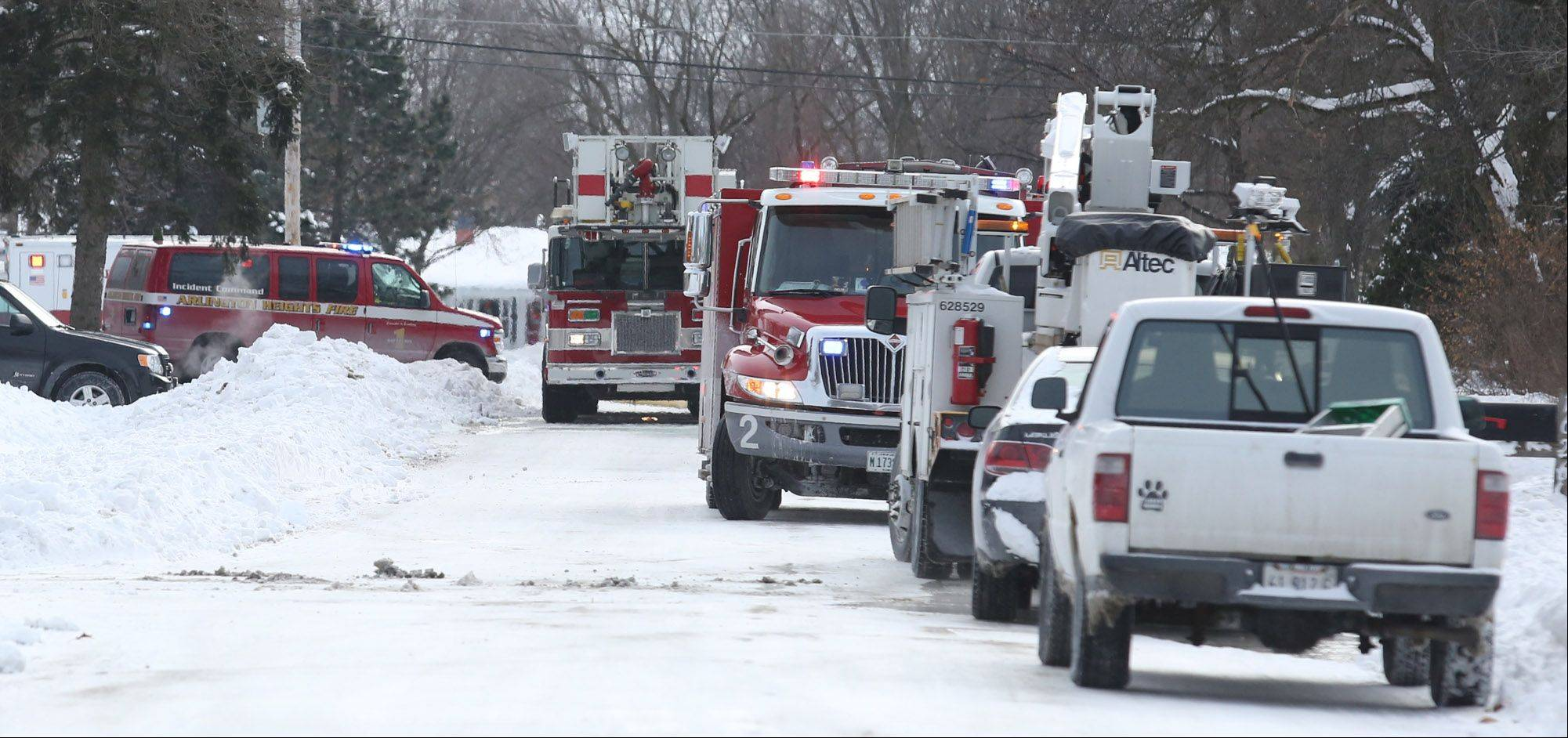 Fire department vehicles from Arlington Heights and other local agencies were on scene Tuesday afternoon during a house fire on the 1600 block of Yale Avenue in Arlington Heights.