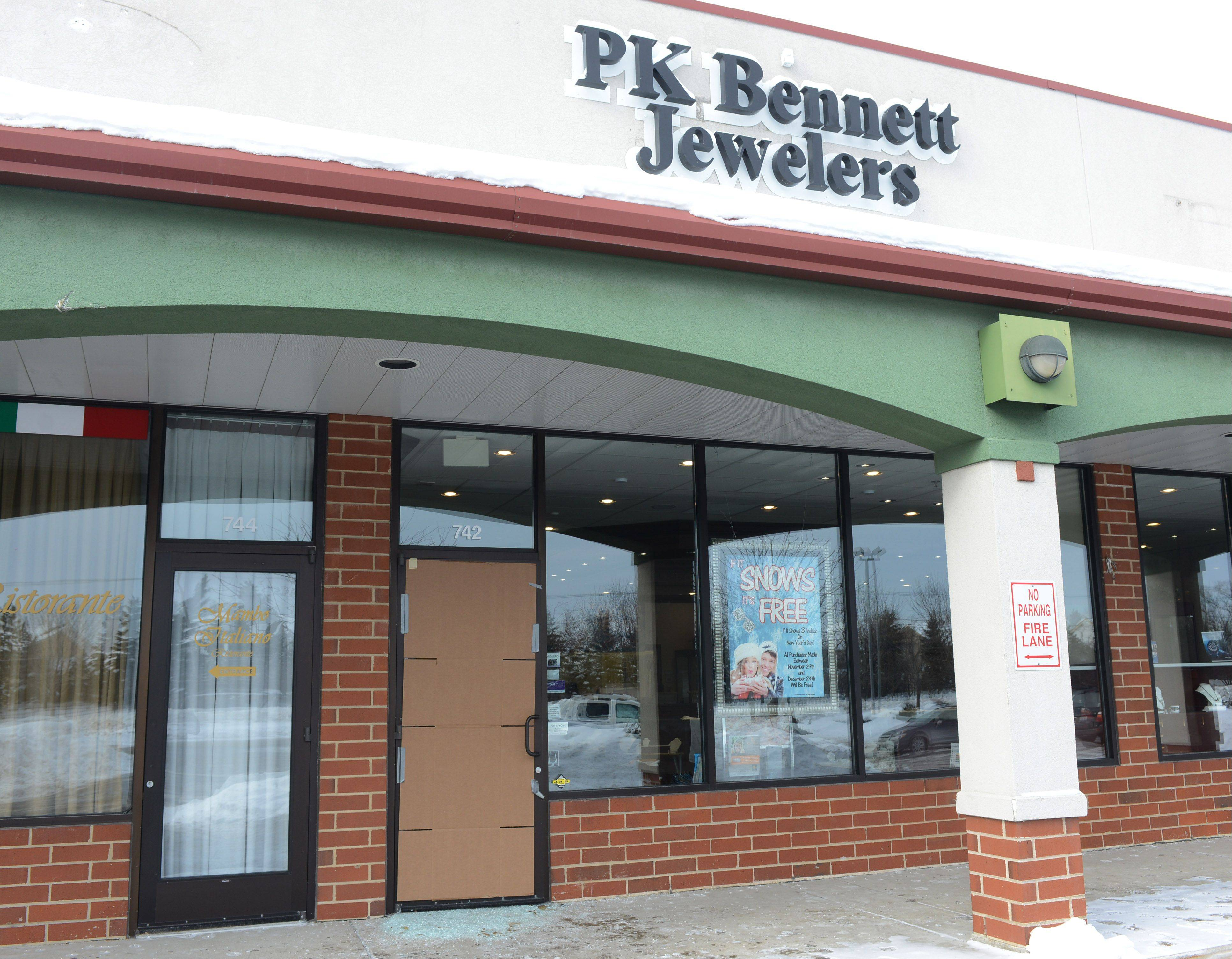 The front door to P.K. Bennett Jewelers was smashed early Tuesday by burglars morning who stole items from inside the Mundelein store. The store made headlines in recent days because of a New Year's Day snow promotion.