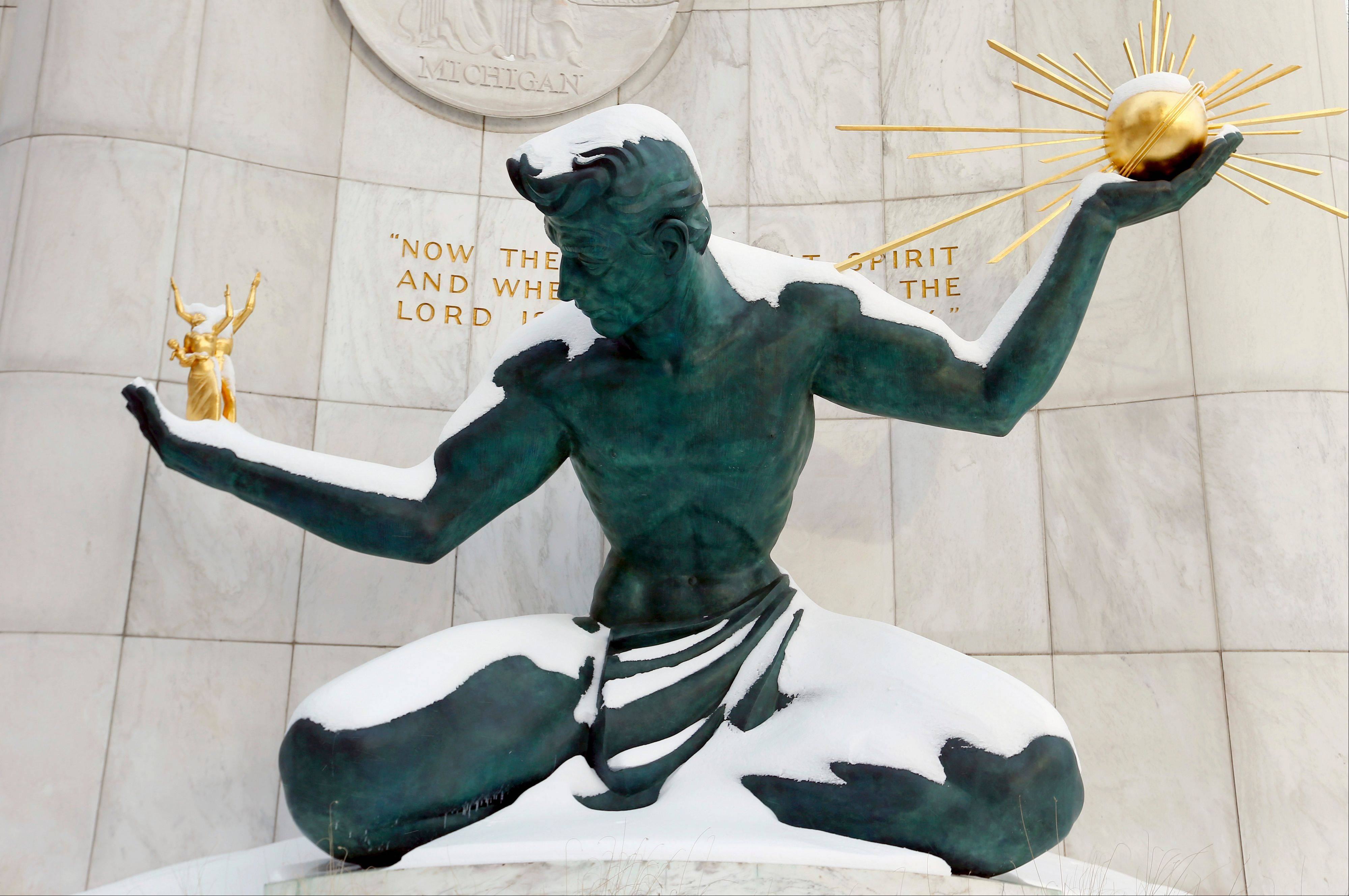 The Spirit of Detroit statue is shown covered in snow in Detroit, Monday, Jan. 6, 2014. Michigan residents are preparing for diving temperatures as they dig out from more than 15 inches of snow in places.