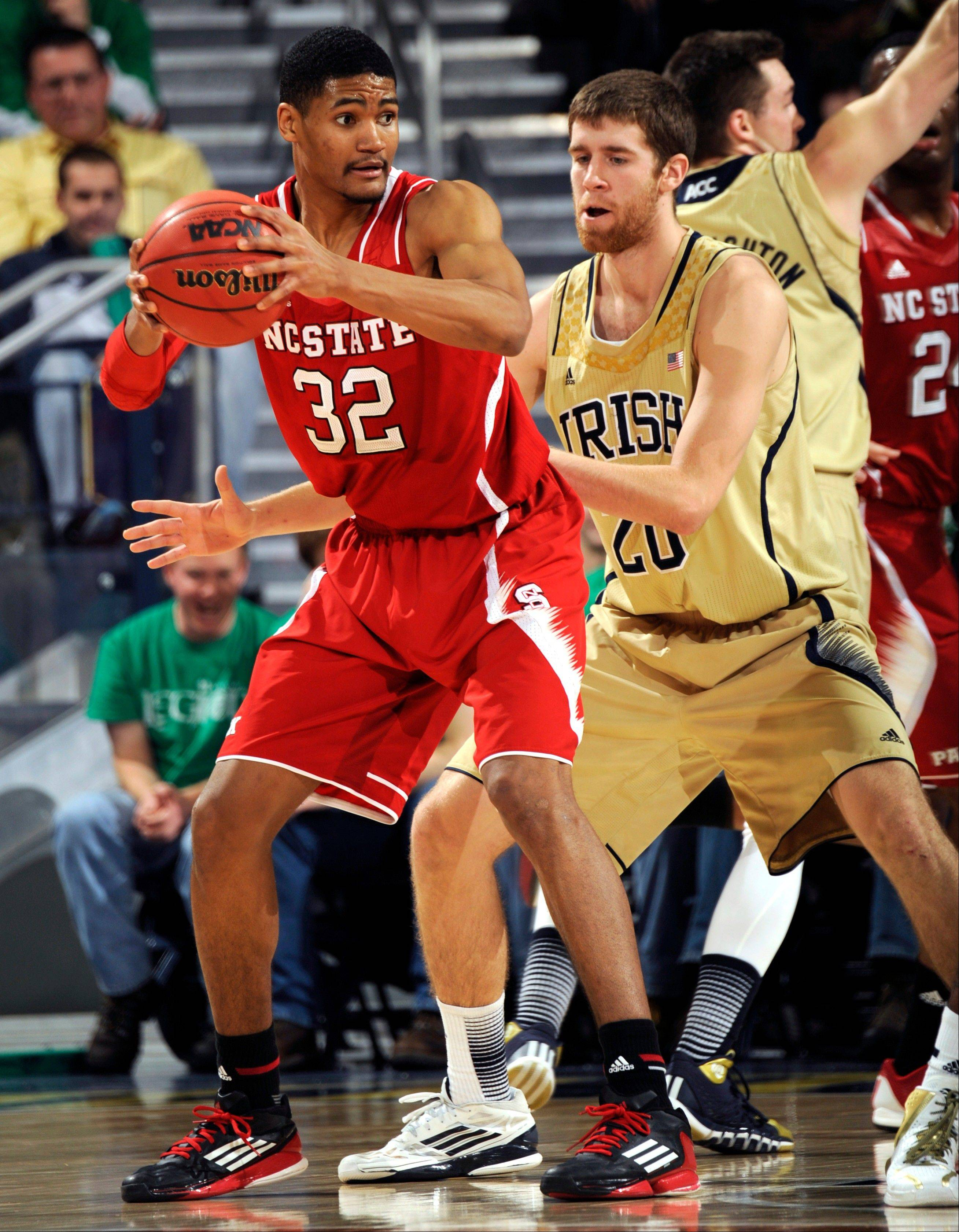 North Carolina State forward Kyle Washington (32) posts up with Notre Dame guard Austin Burgett in the second half of an NCAA college basketball game, Tuesday, Jan. 7, 2014, in South Bend, Ind.