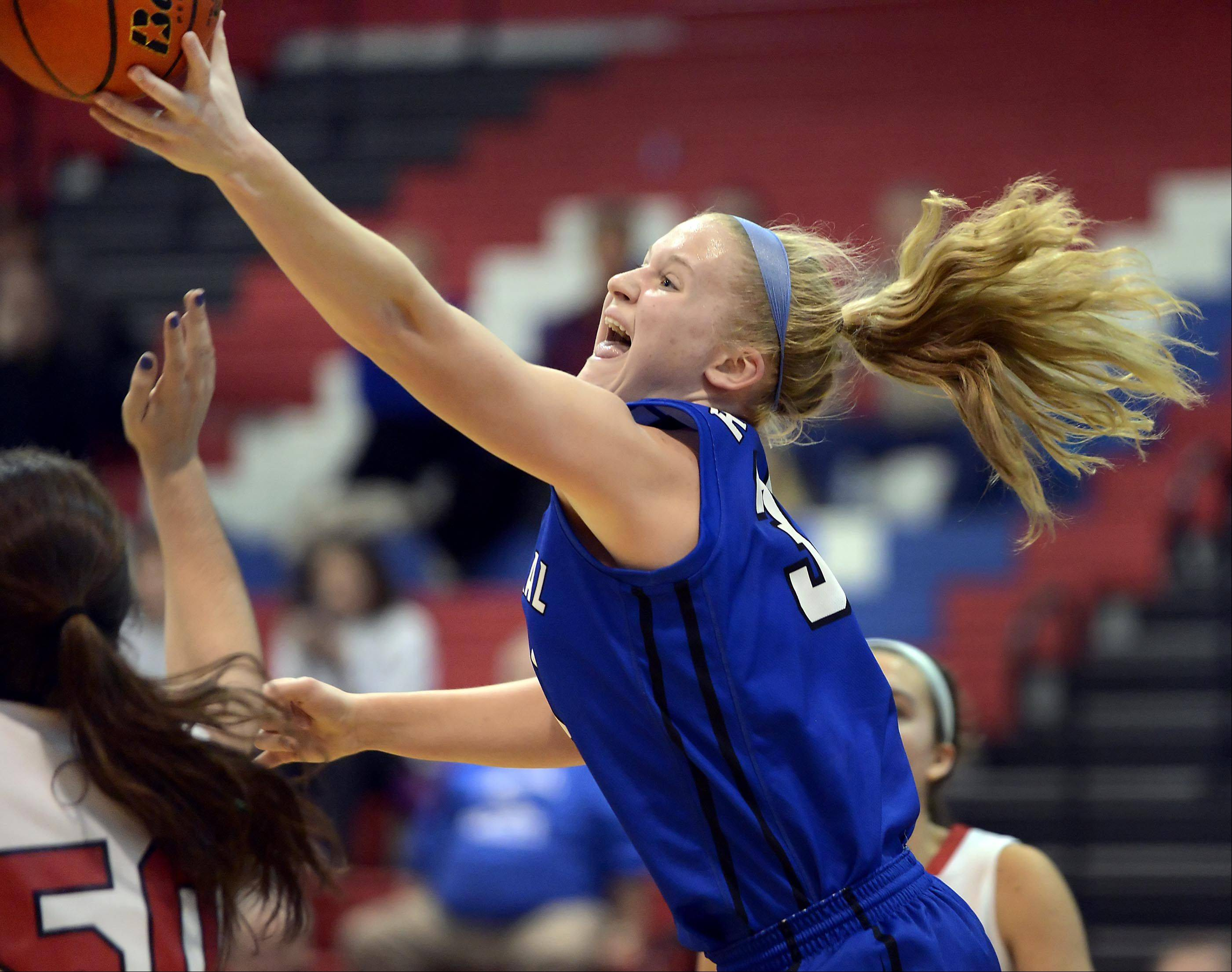 Burlington Central's Sam Pryor reaches for a rebound against Maine South Monday in the consolation game at the 31st Annual Charger Classic girls basketball tournament at Dundee-Crown High School in Carpentersville.