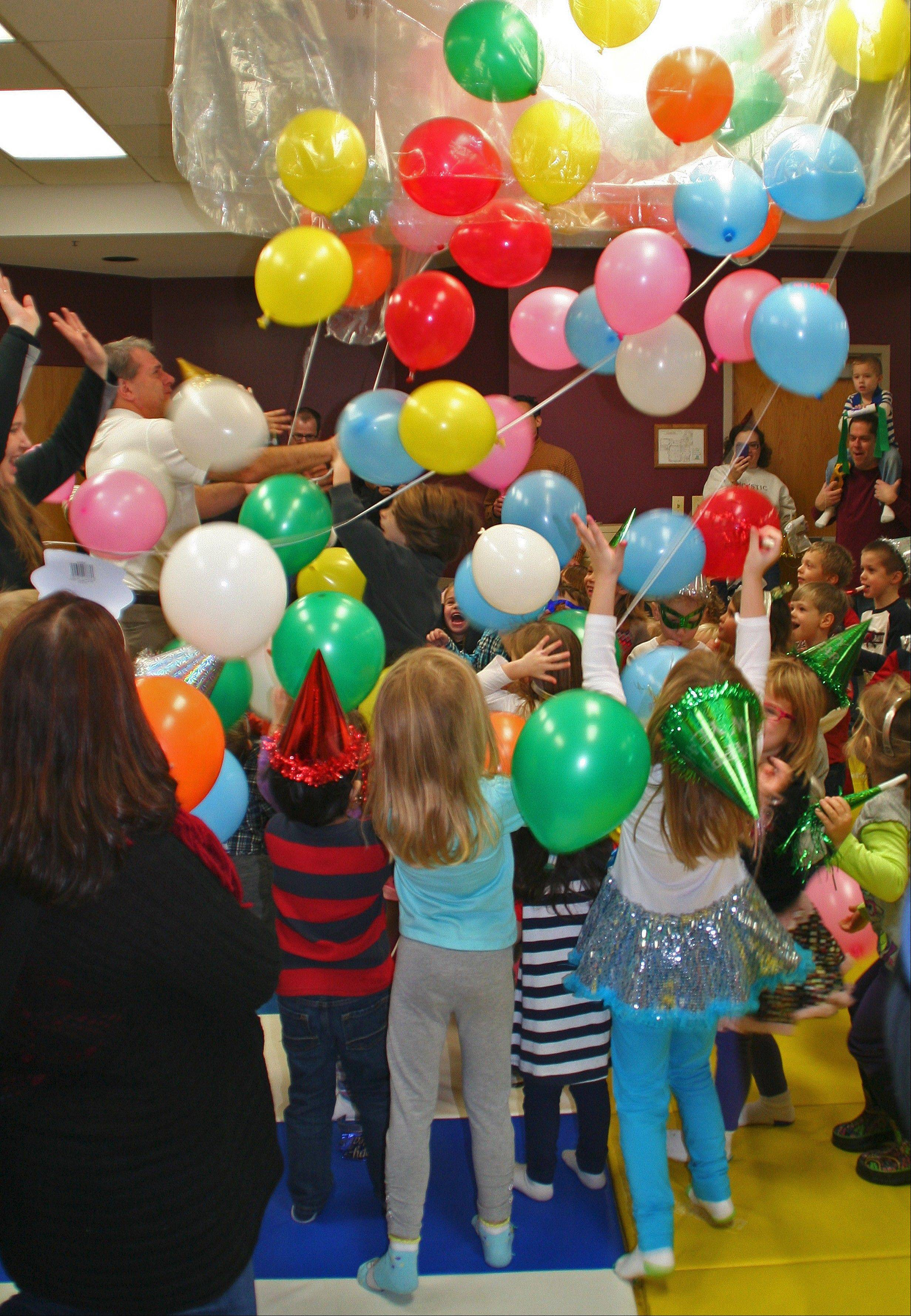 Happy New Year! Children counted down to the noon balloon drop at the Preschool Noon Year's Eve party on Dec. 31, at Prairie Lakes Community Center.