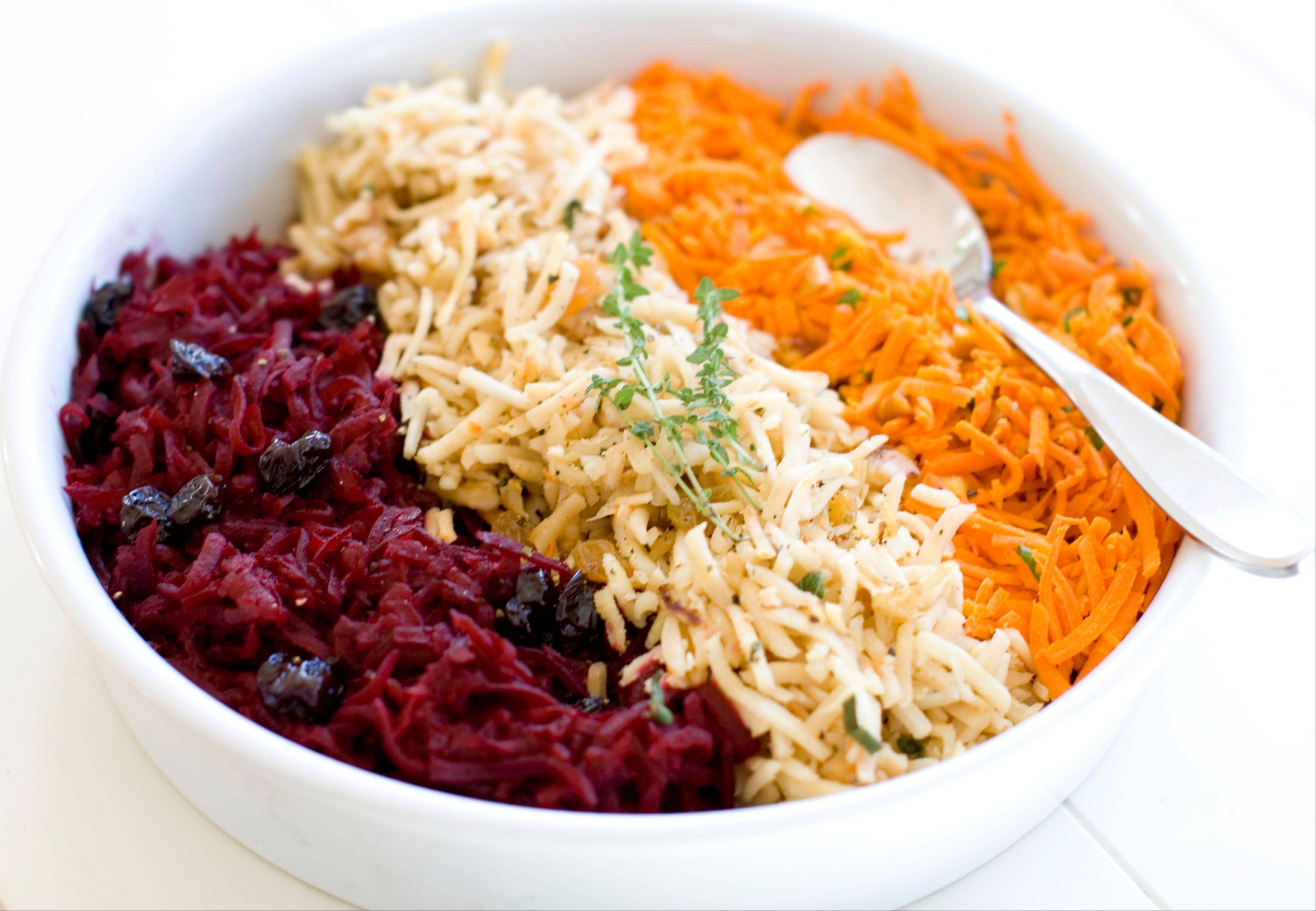 A food processor makes quick work of a trio of sides: shredded beets with balsamic, from left, shredded parsnips with walnuts and shredded spicy carrots.