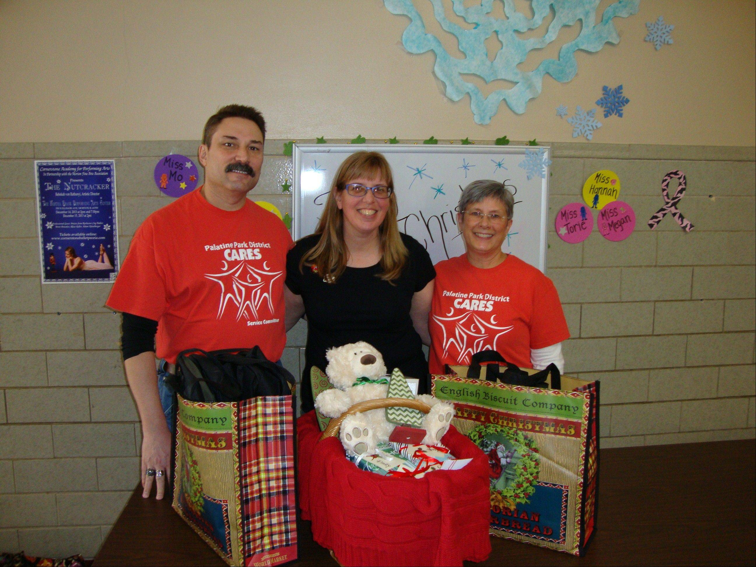Thom Lange, Amy English, Carol Lange deliver gifts to Washington, Ill.