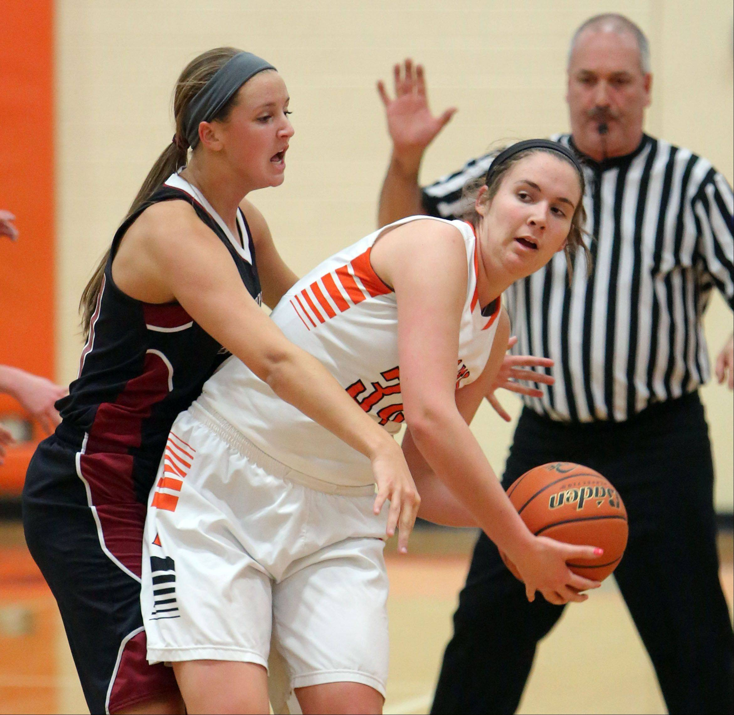 Antioch�s Carly McCameron, left, applies some tough defense on Libertyville�s Becky Deichl on Wednesday at Libertyville.