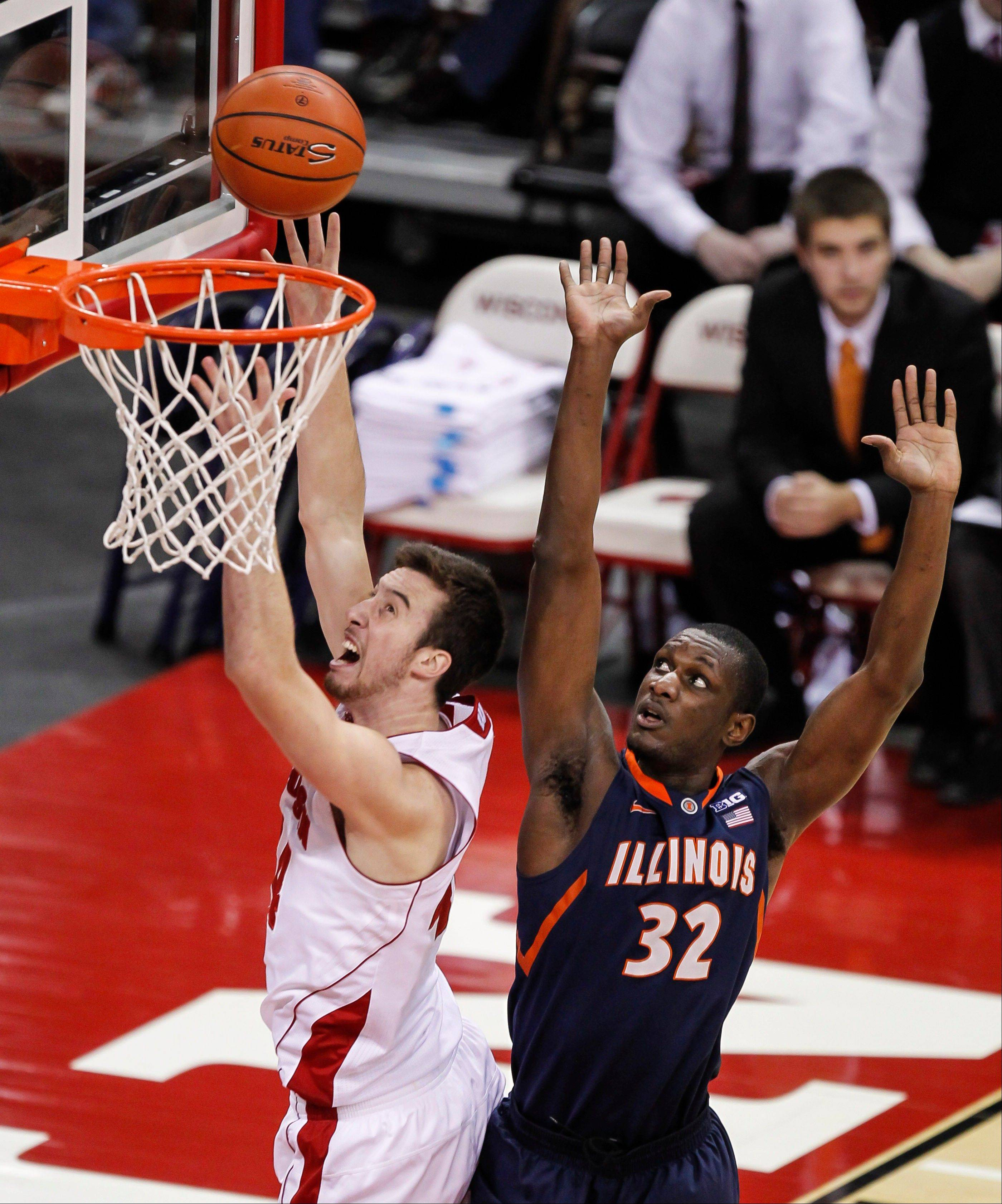 Wisconsin's Frank Kaminsky shoots against Illinois' Nnanna Egwu during the first half of an NCAA college basketball game Wednesday, Jan. 8, 2014, in Madison, Wis. Egwu fouled Kaminsky on the play. (AP Photo/Andy Manis)