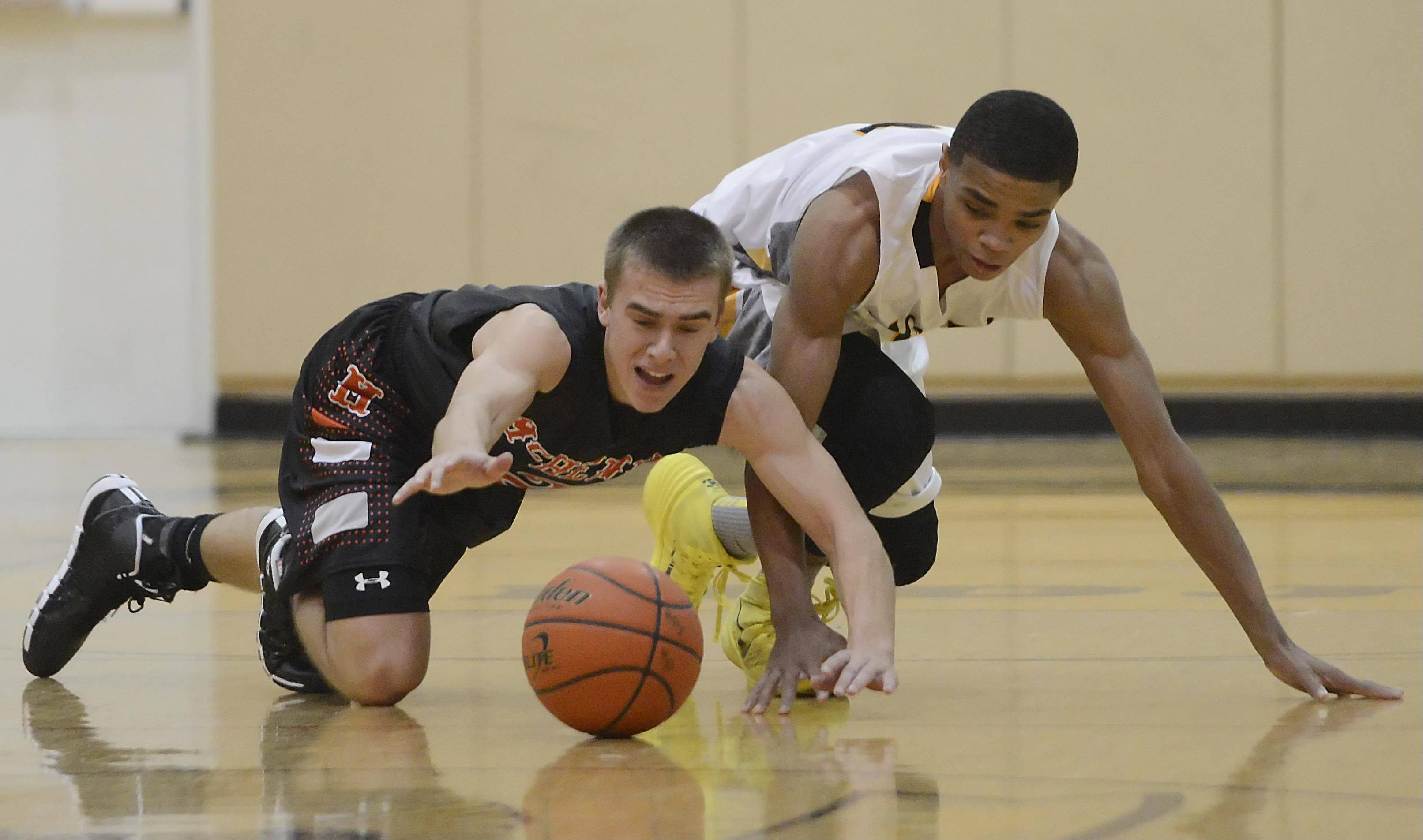 McHenry�s Cody Freund and Jacobs� Kenton Mack scramble for a loose ball.