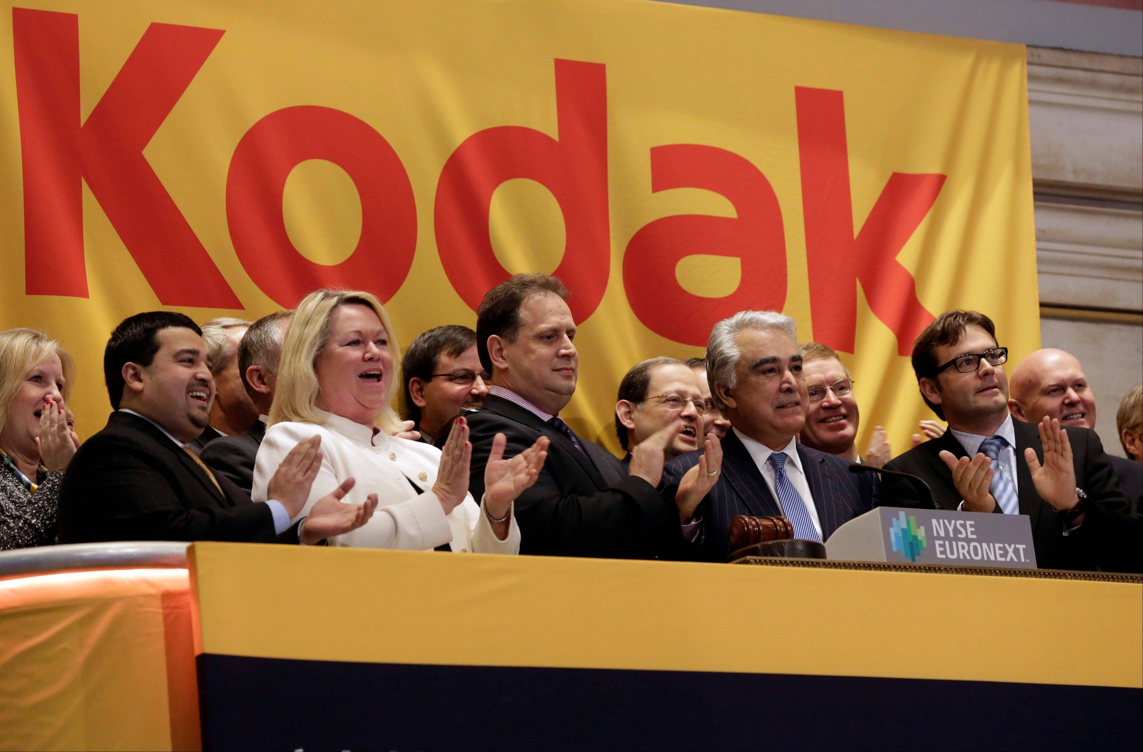 Kodak CEO Antonio Perez, right center, rings the opening bell of the New York Stock Exchange Wednesday. The stock market stumbled Wednesday as investors waited for the government's jobs report later this week and the beginning of quarterly earnings releases from corporate America.