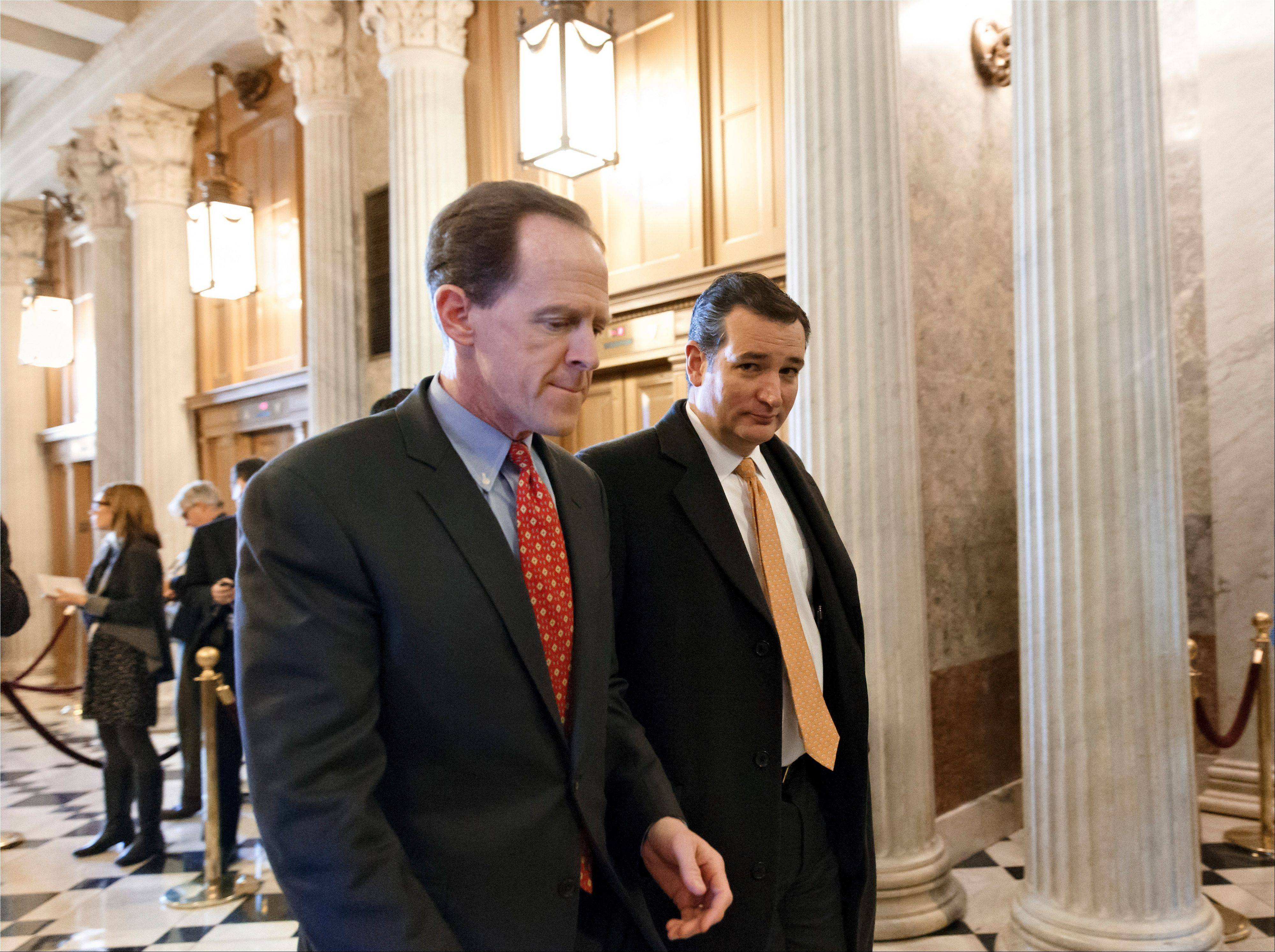 Sen. Pat Toomey, R-Pa., left, and Sen. Ted Cruz, R-Texas, right, arrive at the Senate on Capitol Hill in Washington, Tuesday for a procedural vote on legislation to renew jobless benefits for the long-term unemployed. The vote was 60-37 to limit debate on the legislation, with a half-dozen Republicans siding with the Democrats on the test vote.