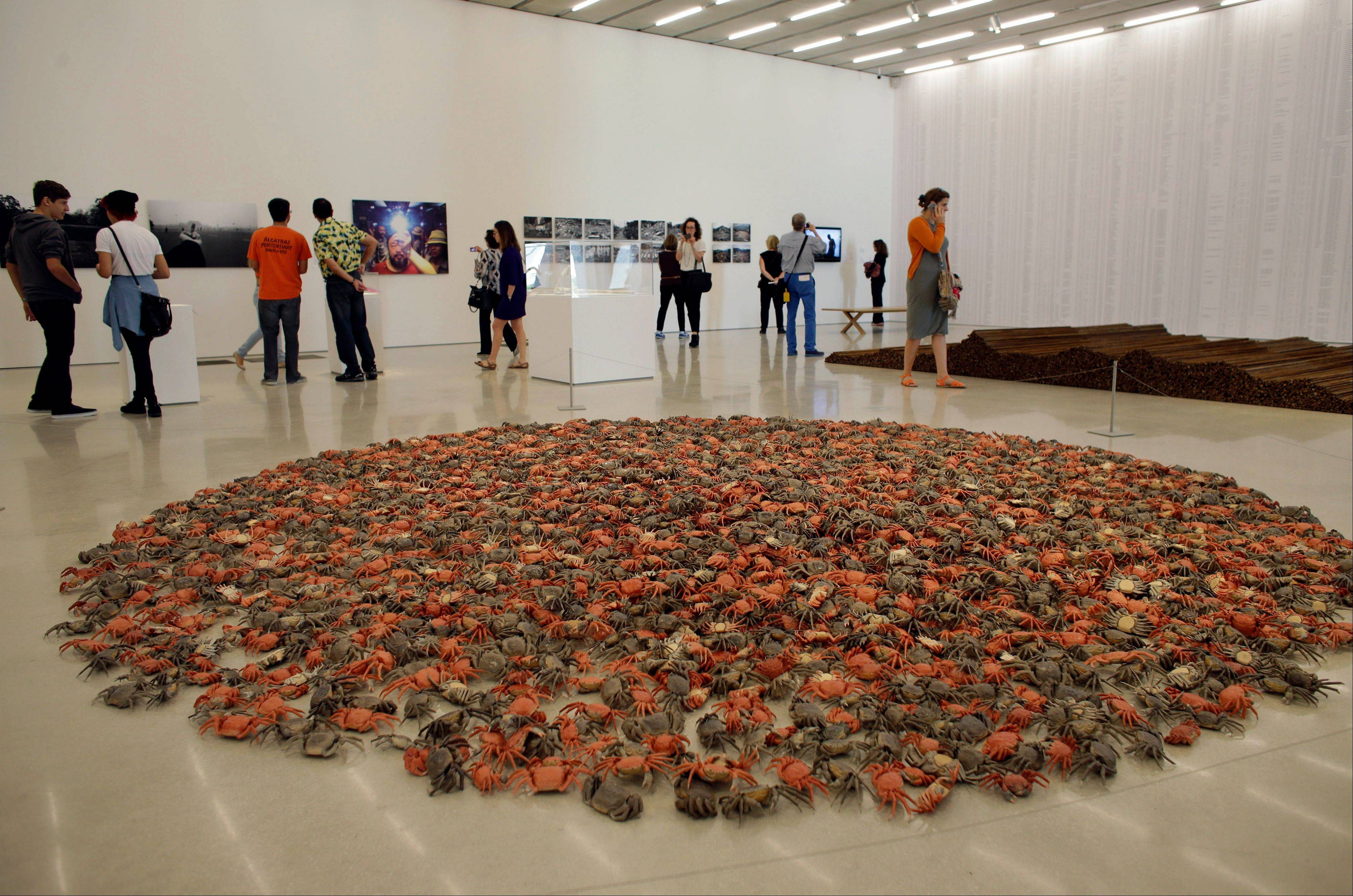 "A piece titled ""He Xie"" featuring 3,200 porcelain crabs by the Chinese artist Ai Weiwei is on display at the new Perez Art Museum Miami in Miami."