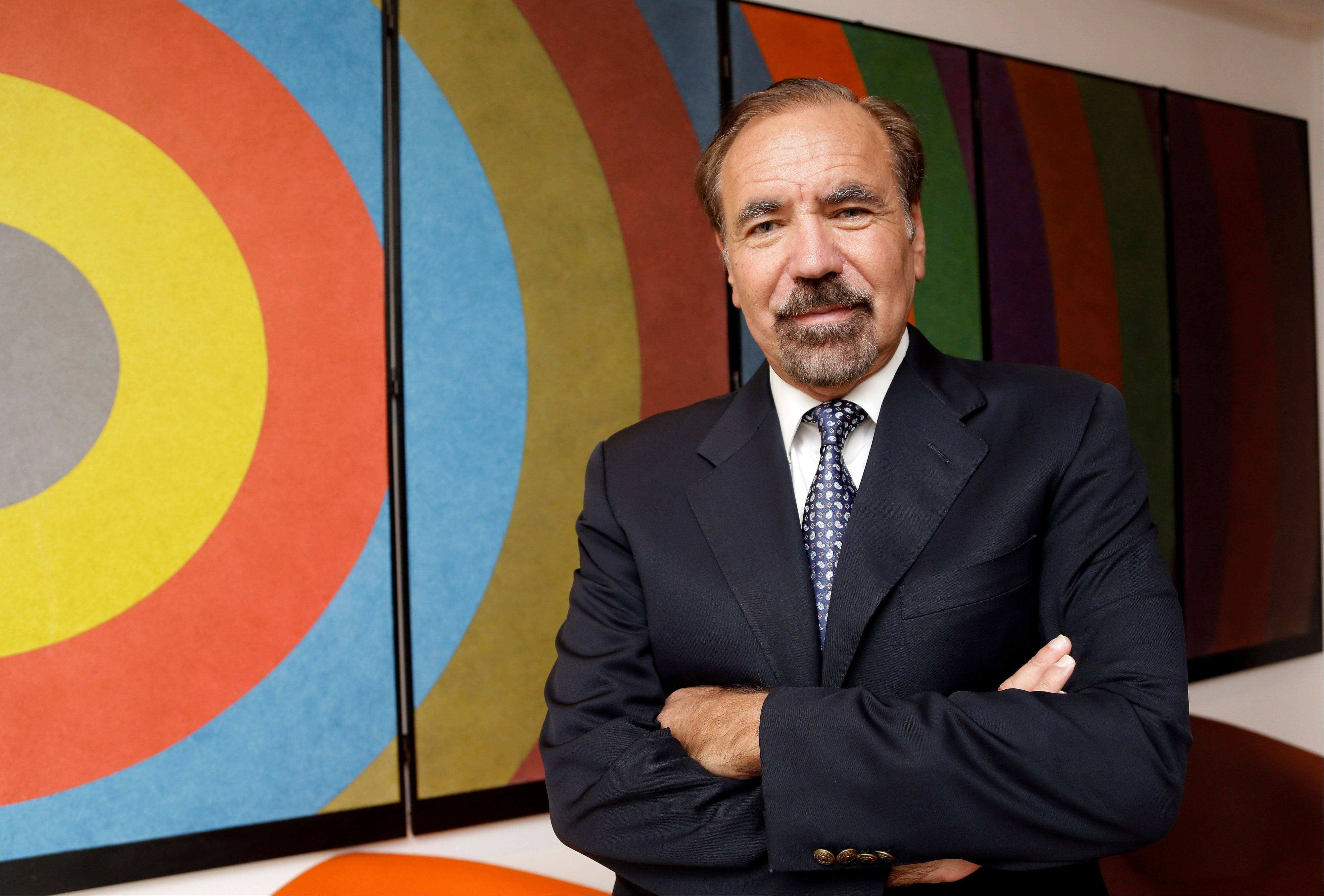 "Developer and art collector Jorge Perez stands in front of a piece by artist Sol LeWitt and is titled ""Folding Screen 3 C-Arcs from the Midpoint of the Left Side."" Perez, a major force behind Miami's urban development, donated a combined $40 million in cash and art, earning naming rights to the newly opened Perez Art Museum Miami."
