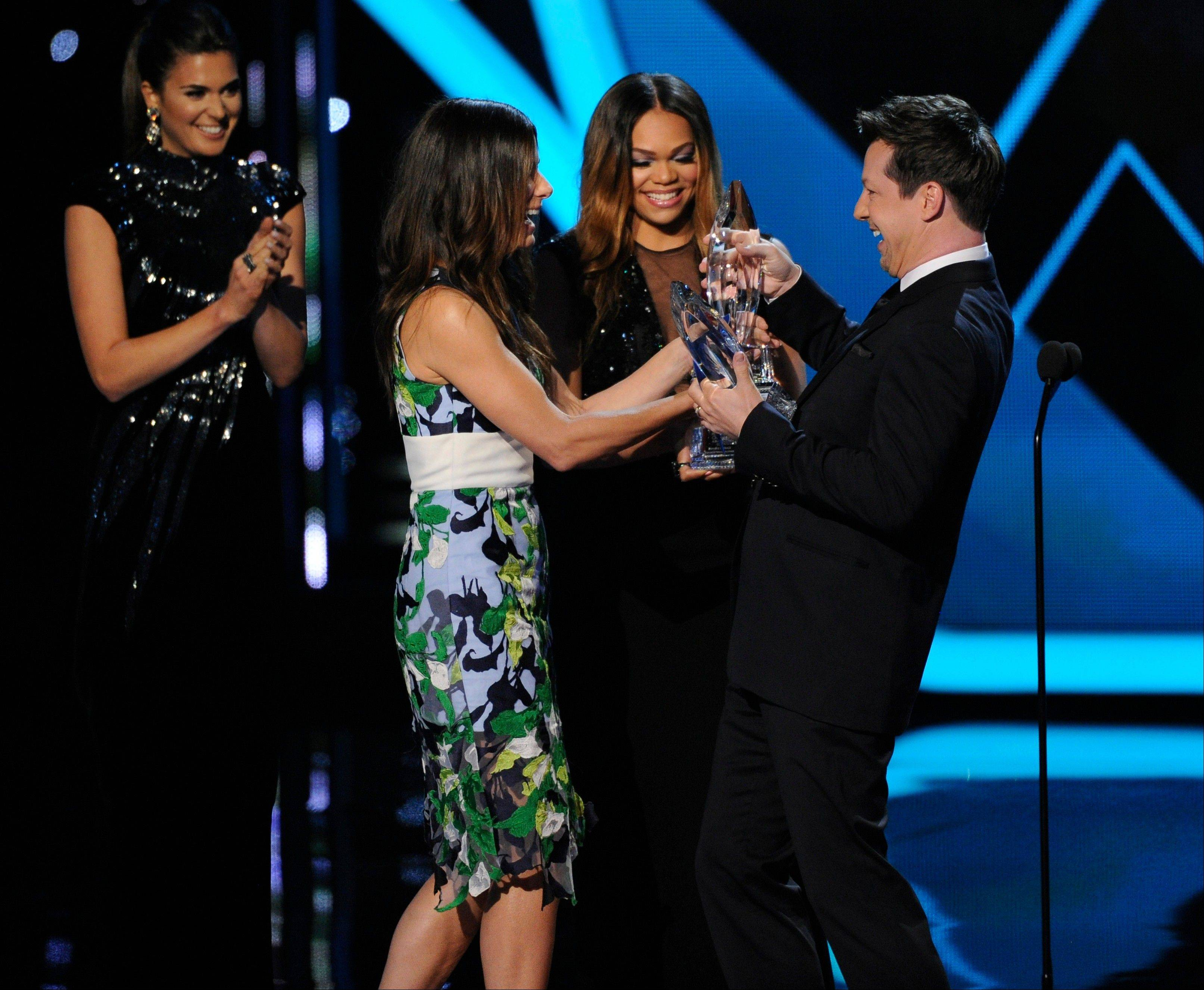 Associated PressSean Hayes, right, presents the award for favorite movie actress to Sandra Bullock, second left, at the 40th annual People's Choice Awards at the Nokia Theatre L.A. Live on Wednesday, Jan. 8, 2014, in Los Angeles.