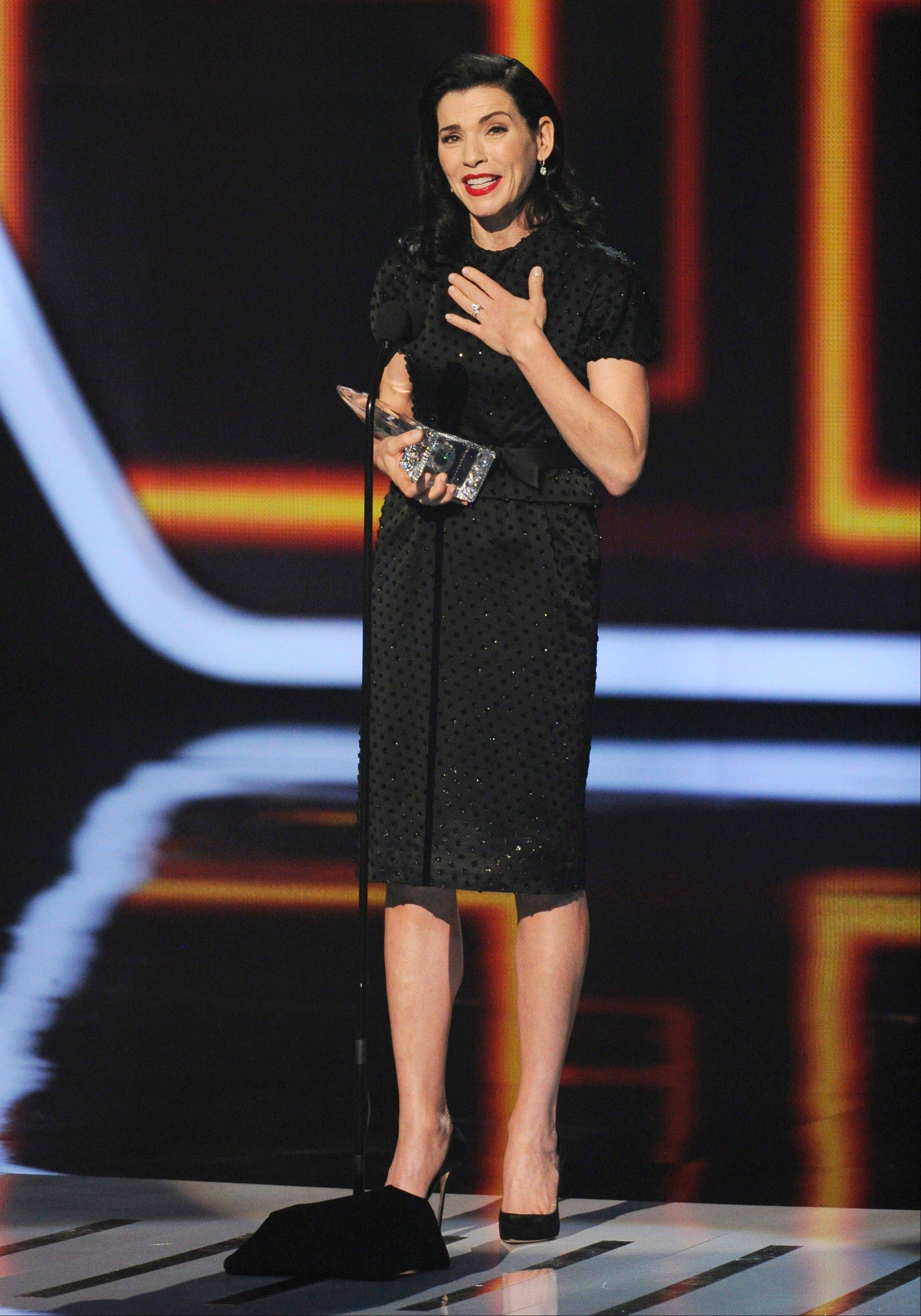 Associated PressJulianna Margulies accepts the award for favorite network TV drama at the 40th annual People's Choice Awards at the Nokia Theatre L.A. Live on Wednesday, Jan. 8, 2014, in Los Angeles.