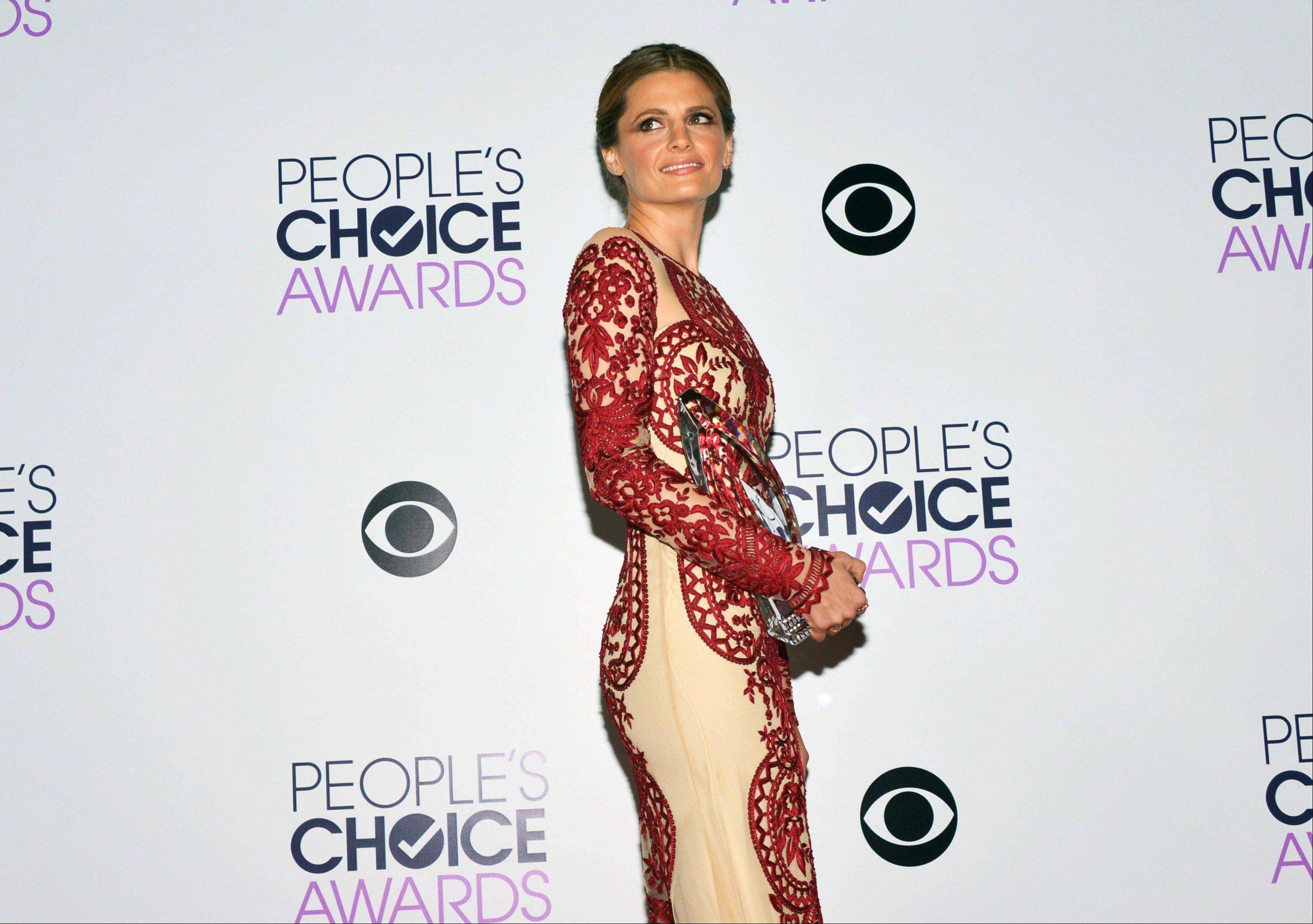 Associated PressStana Katic poses in the press room with the award for Favorite Dramatic TV Actress for 'Castle,' at the 40th annual People's Choice Awards at Nokia Theatre L.A. Live on Wednesday, Jan. 8, 2014, in Los Angeles.