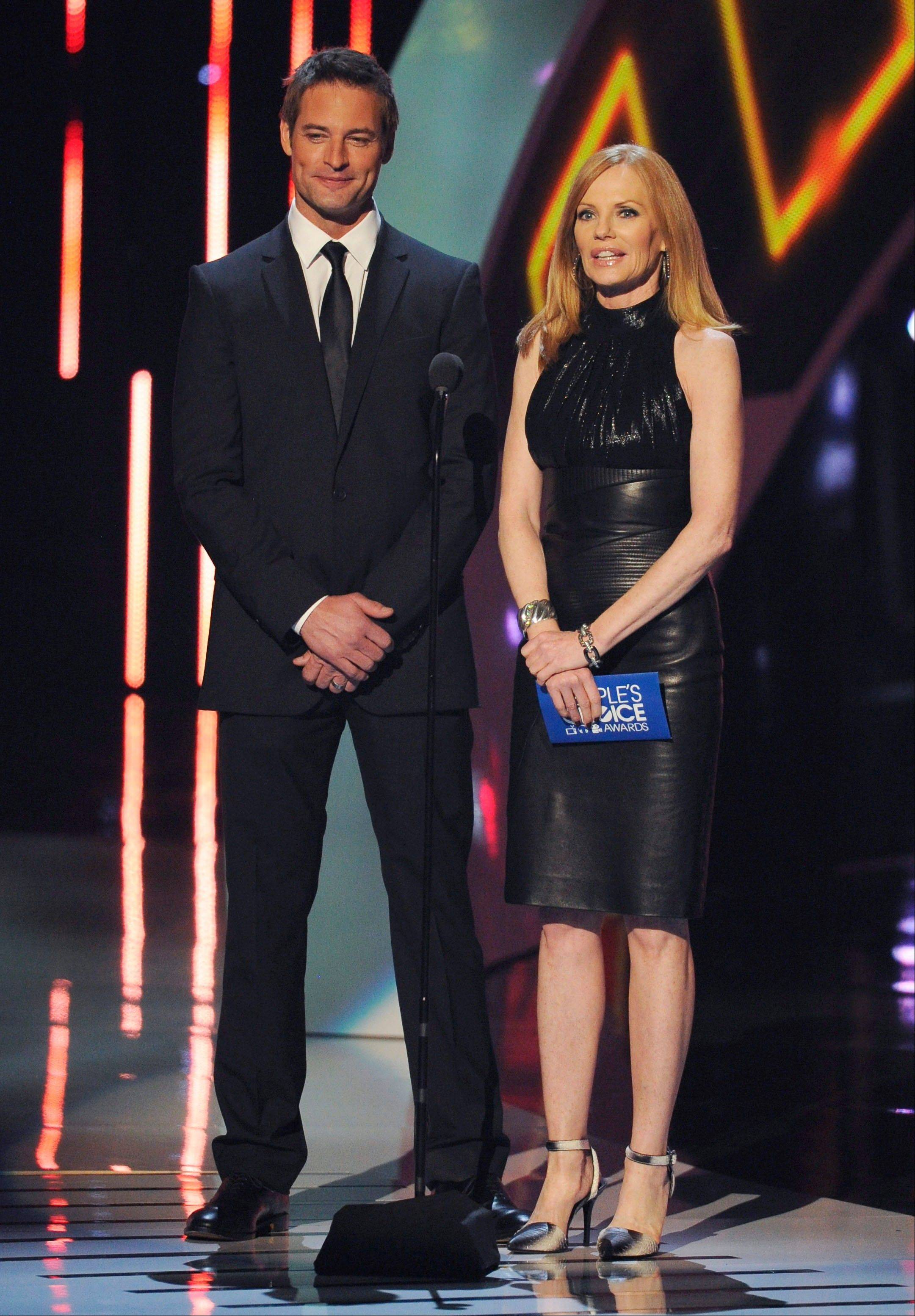 Associated PressJosh Holloway, left, and Marg Helgenberger present the award for favorite network TV drama at the 40th annual People's Choice Awards at the Nokia Theatre L.A. Live on Wednesday, Jan. 8, 2014, in Los Angeles.