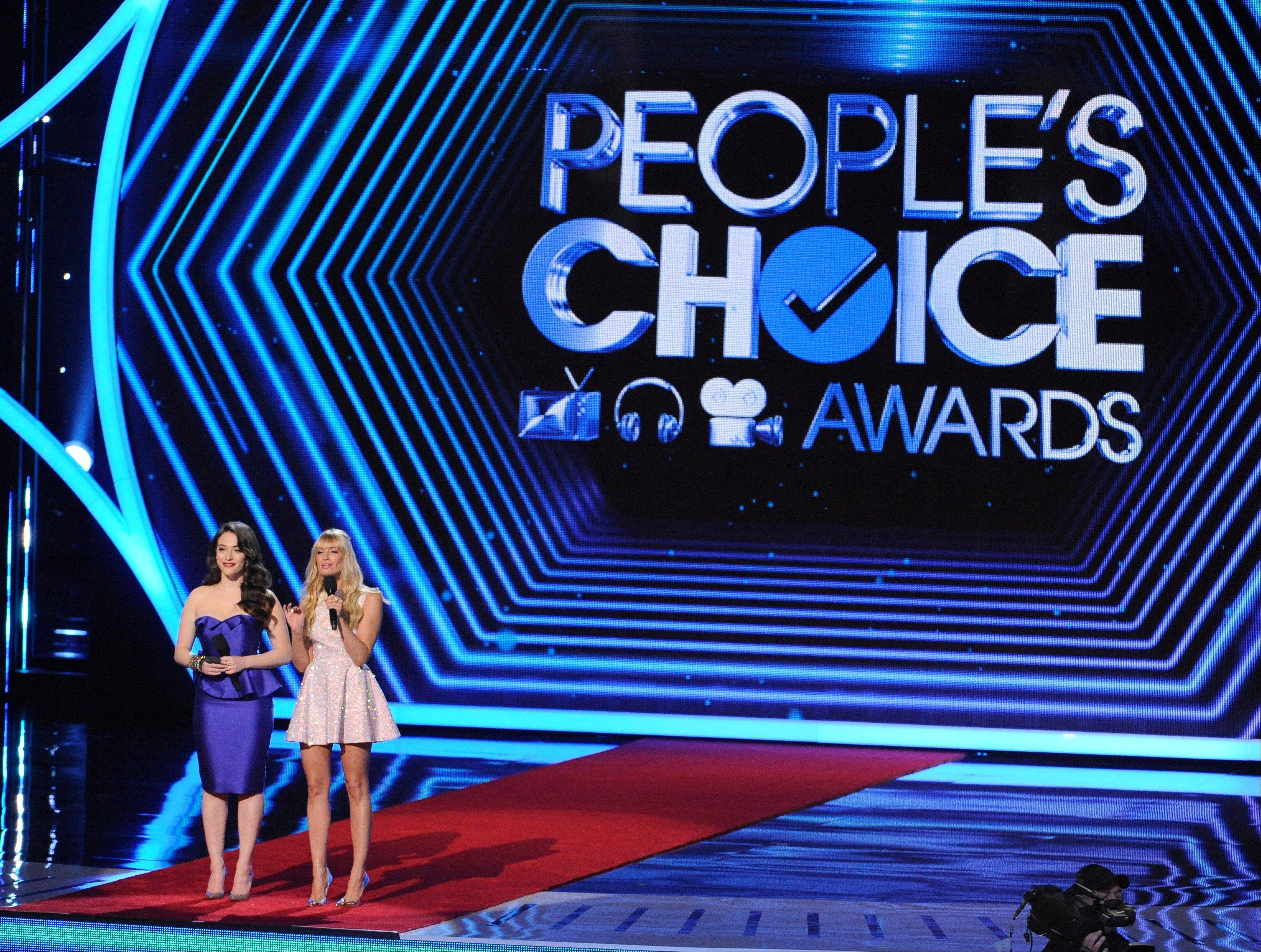 Associated PressHosts Kat Dennings, left, and Beth Behrs speak on stage at the 40th annual People's Choice Awards at the Nokia Theatre L.A. Live on Wednesday, Jan. 8, 2014, in Los Angeles.