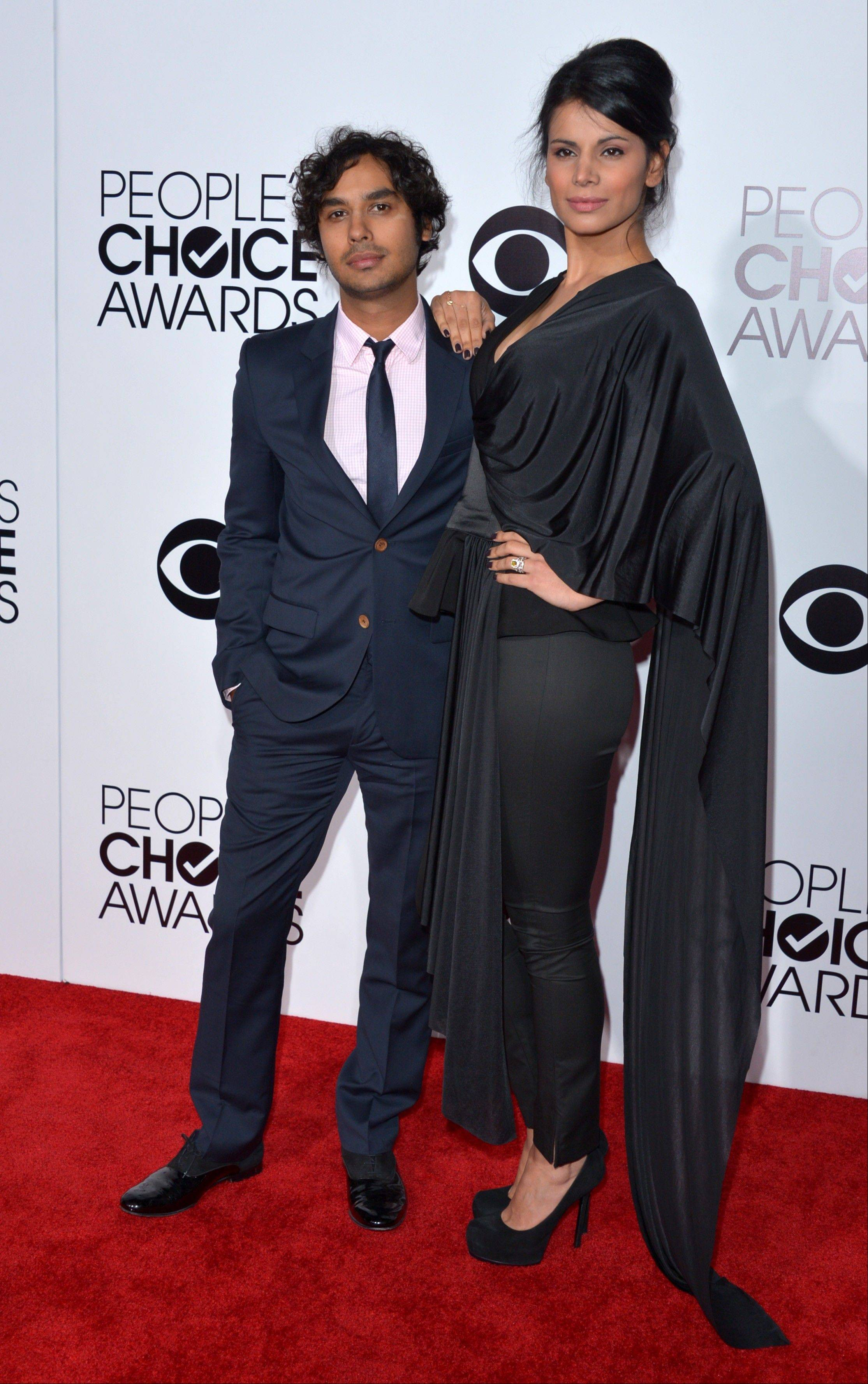 Associated PressKunal Nayyar, left, and Neha Kapur arrive at the 40th annual People's Choice Awards at Nokia Theatre L.A. Live on Wednesday, Jan. 8, 2014, in Los Angeles.