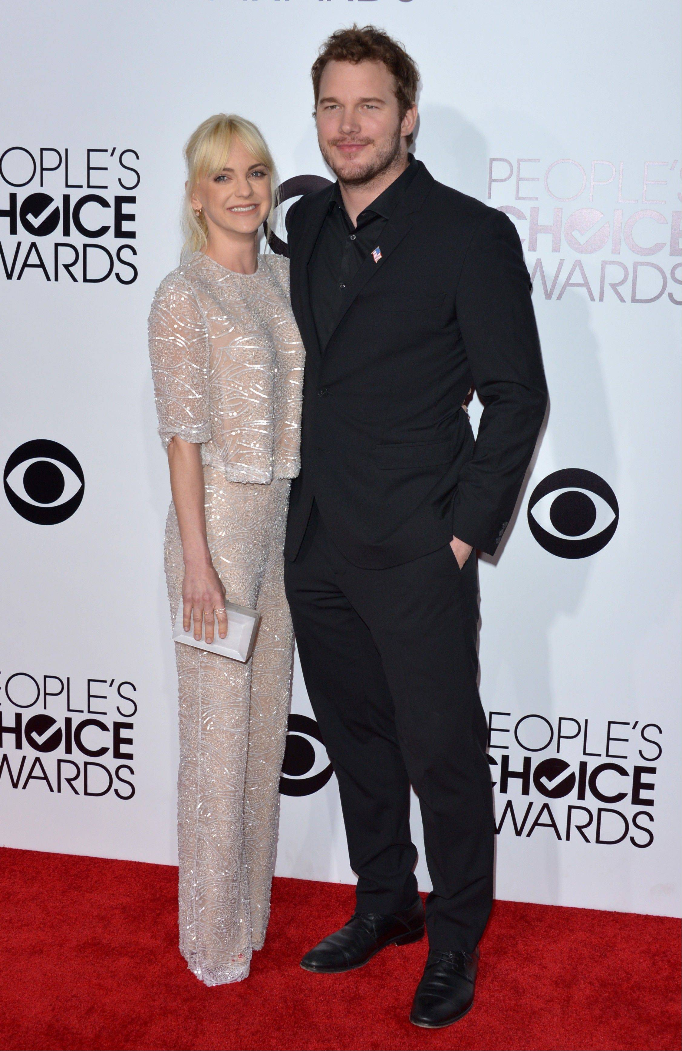 Associated PressAnna Faris, left, and Chris Pratt arrive at the 40th annual People's Choice Awards Wednesday in Los Angeles.