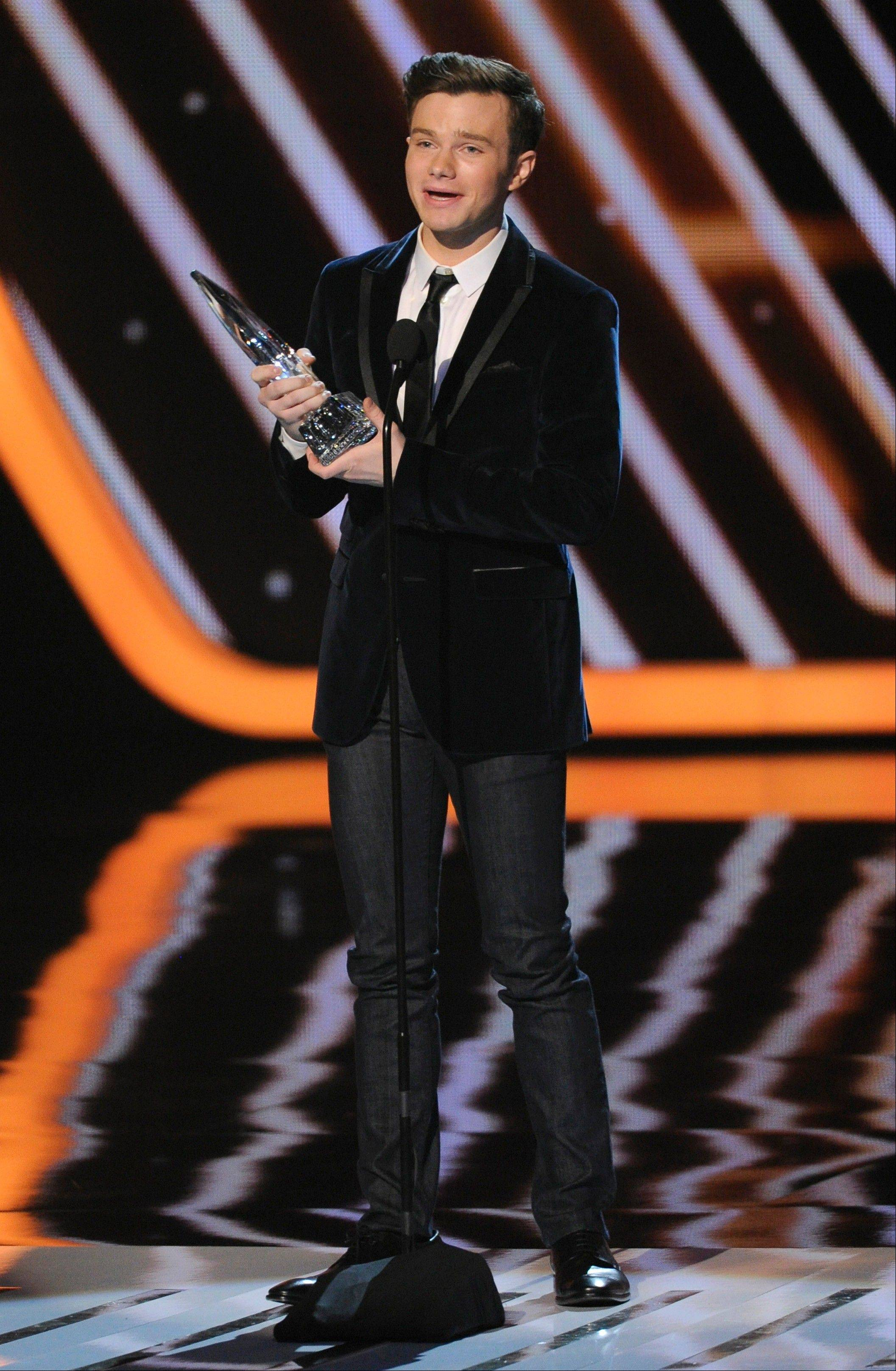 Chris Colfer accepts the award for favoritChris Colfer accepts the award for favorite comedic TV actor at the 40th annual People's Choice Awards.