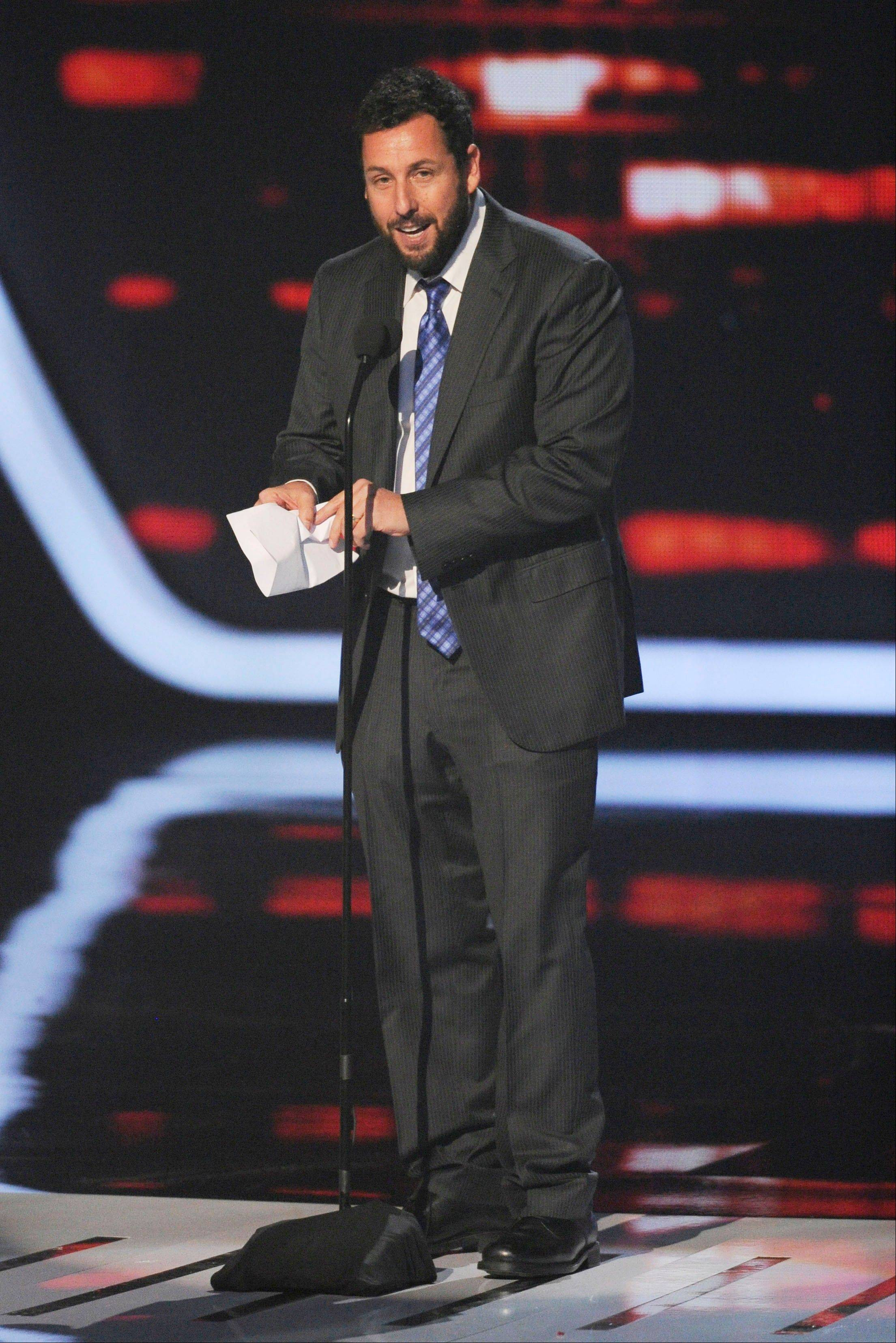 Adam Sandler accepts the award for favorite comedic movie actor at the 40th annual People's Choice Awards.