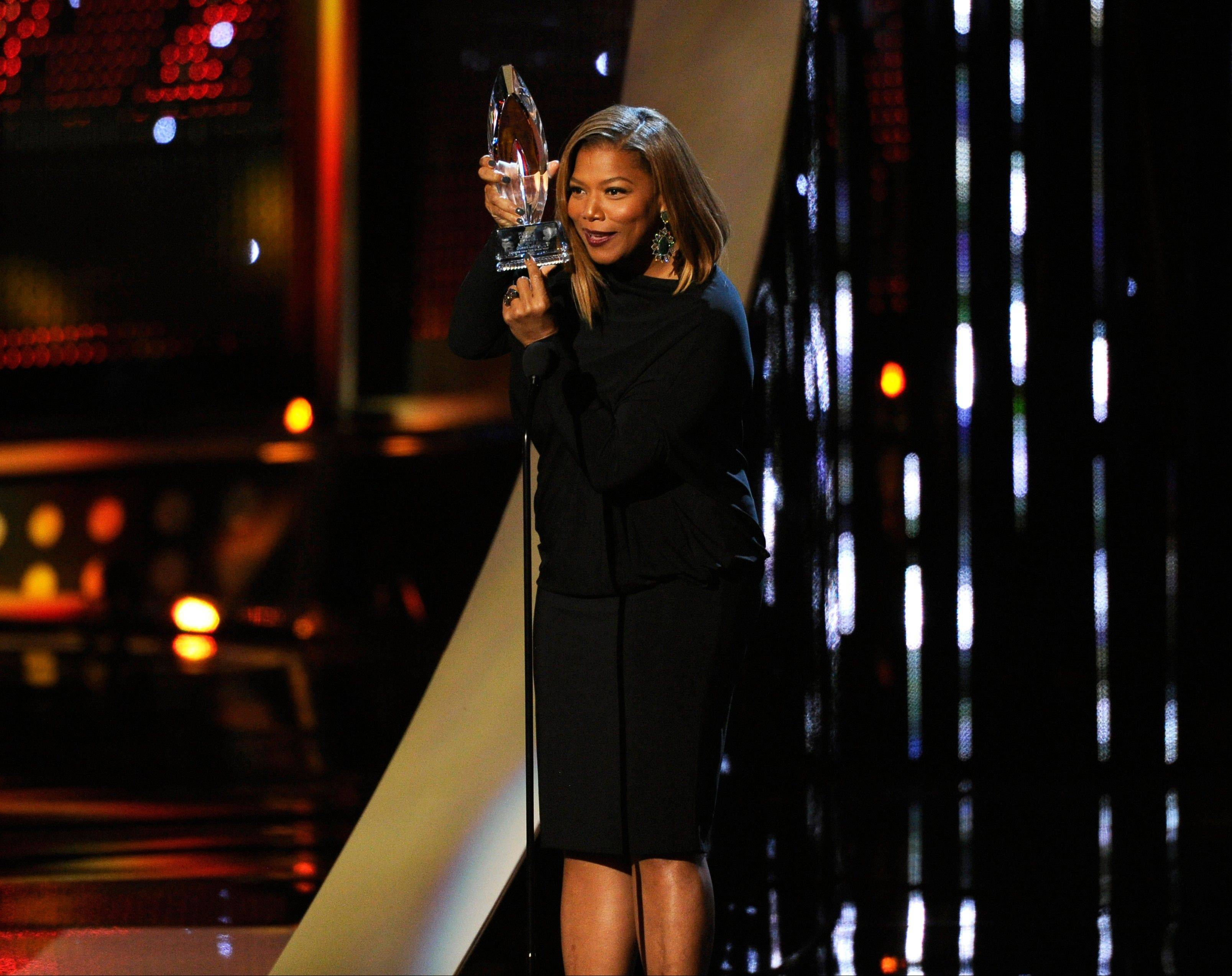 Queen Latifah accepts the award for favorite new talk show host at the 40th annual People's Choice Awards at the Nokia Theatre L.A. Live on Wednesday.