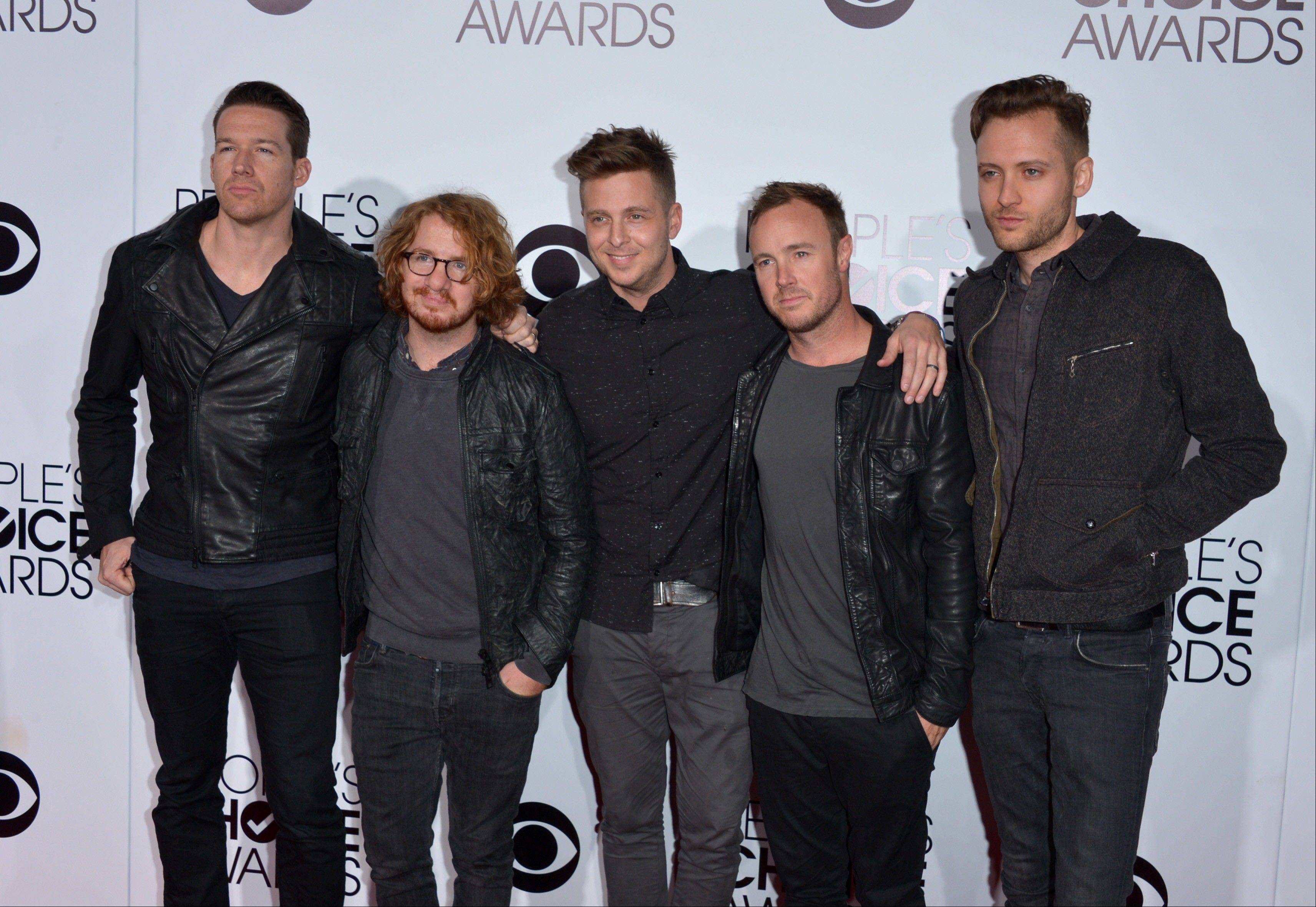 Associated PressMusical group OneRepublic arrives at the 40th annual People's Choice Awards Wednesday in Los Angeles.