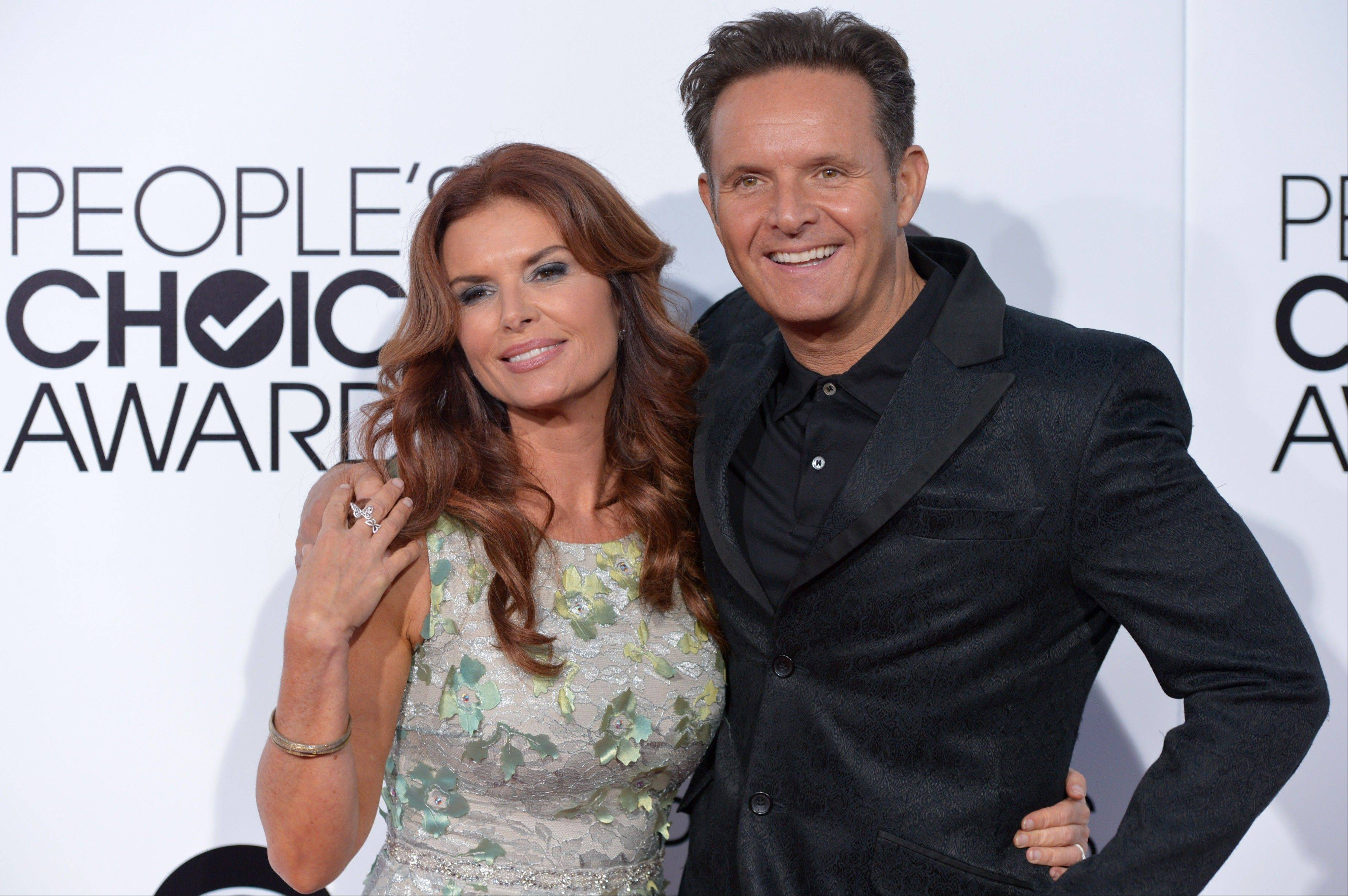 Associated PressRoma Downey, left, and Mark Burnett arrive at the 40th annual People's Choice Awards Wednesday in Los Angeles.