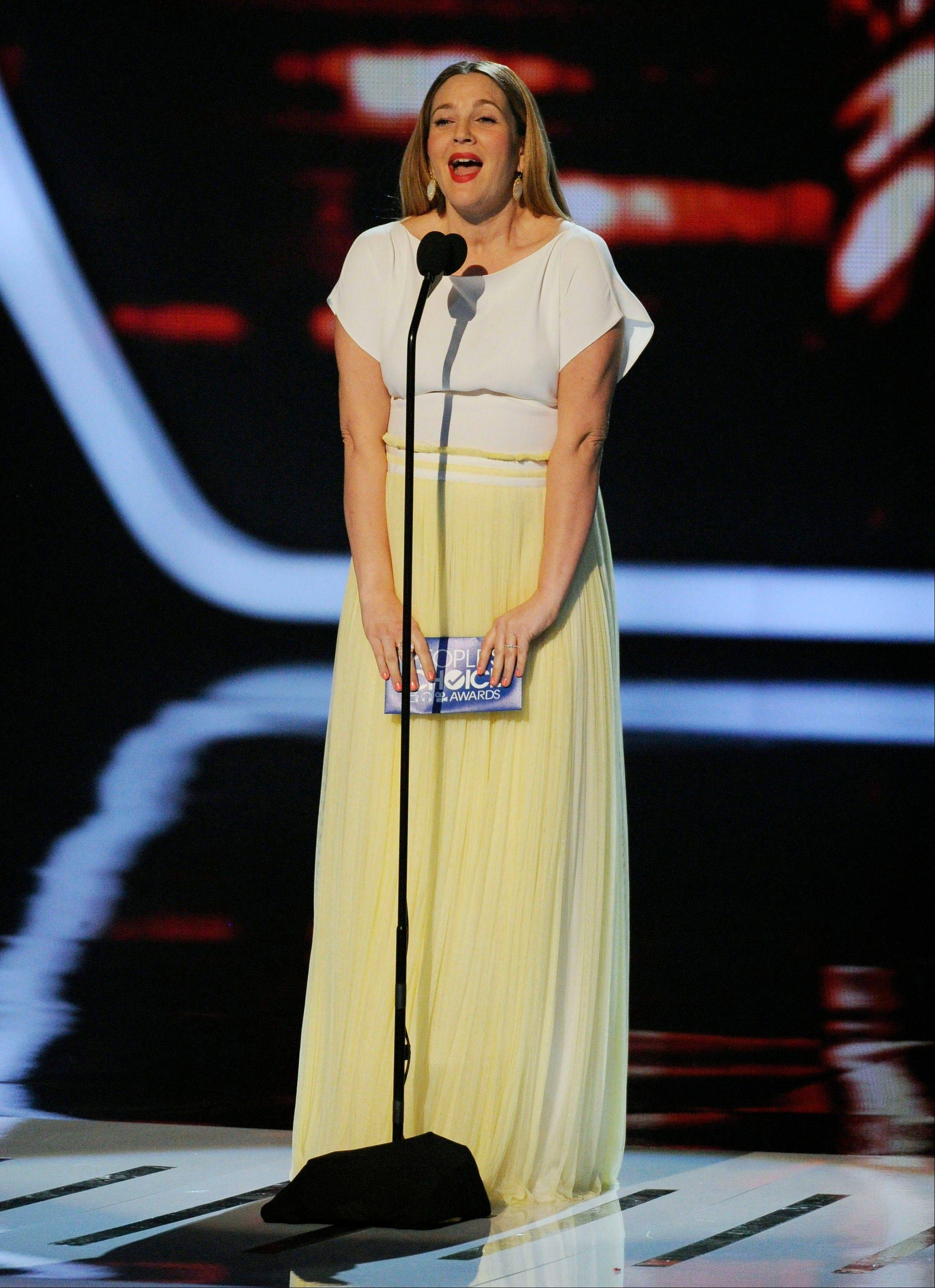 Associated PressDrew Barrymore presents the award for favorite comedic movie actor at the 40th annual People's Choice Awards Wednesday in Los Angeles.
