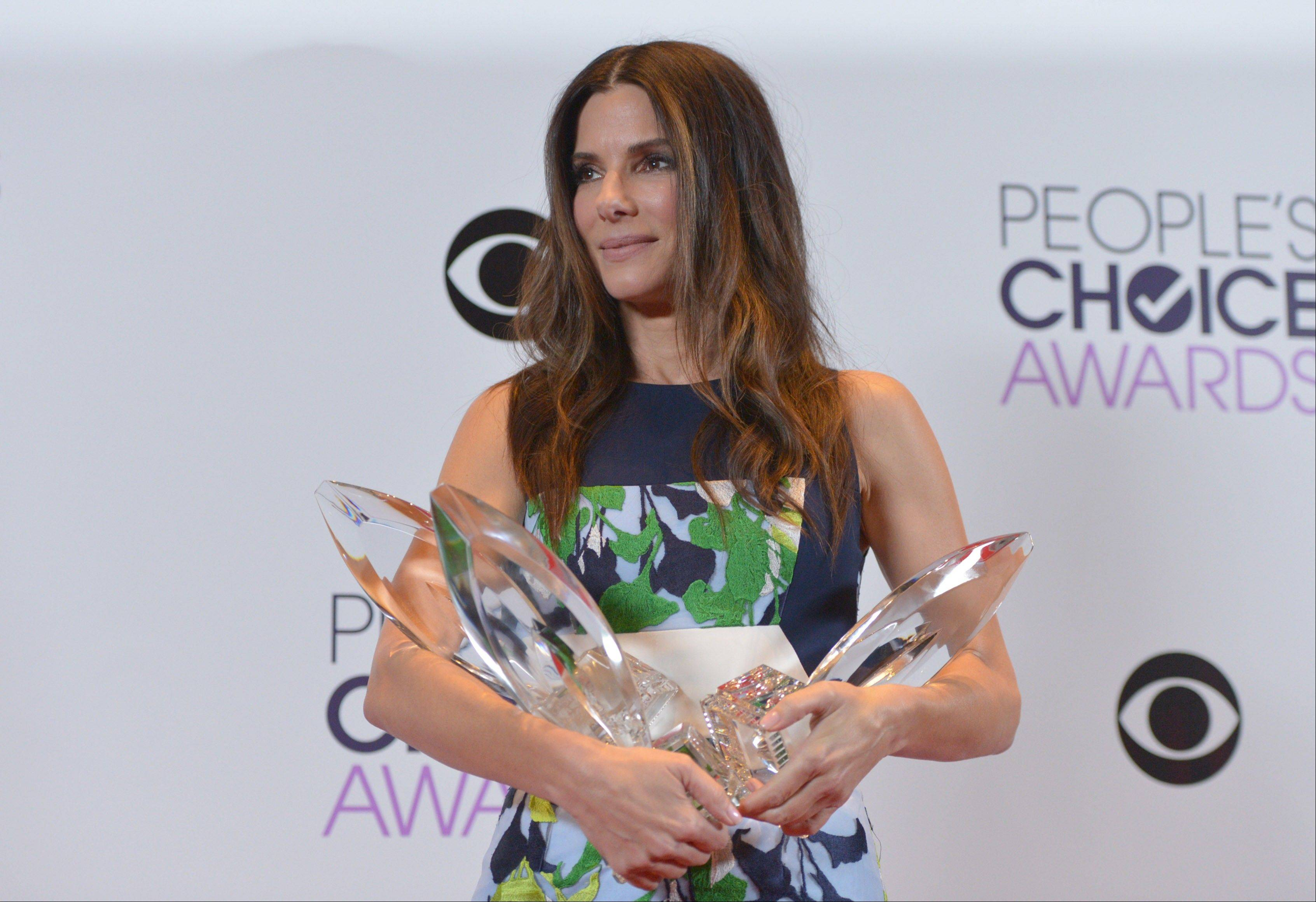 Sandra Bullock won Favorite Movie Actress, Favorite Dramatic Movie Actress and Favorite Comedic Movie Actress Wednesday night at the 40th annual People's Choice Awards in Los Angeles.