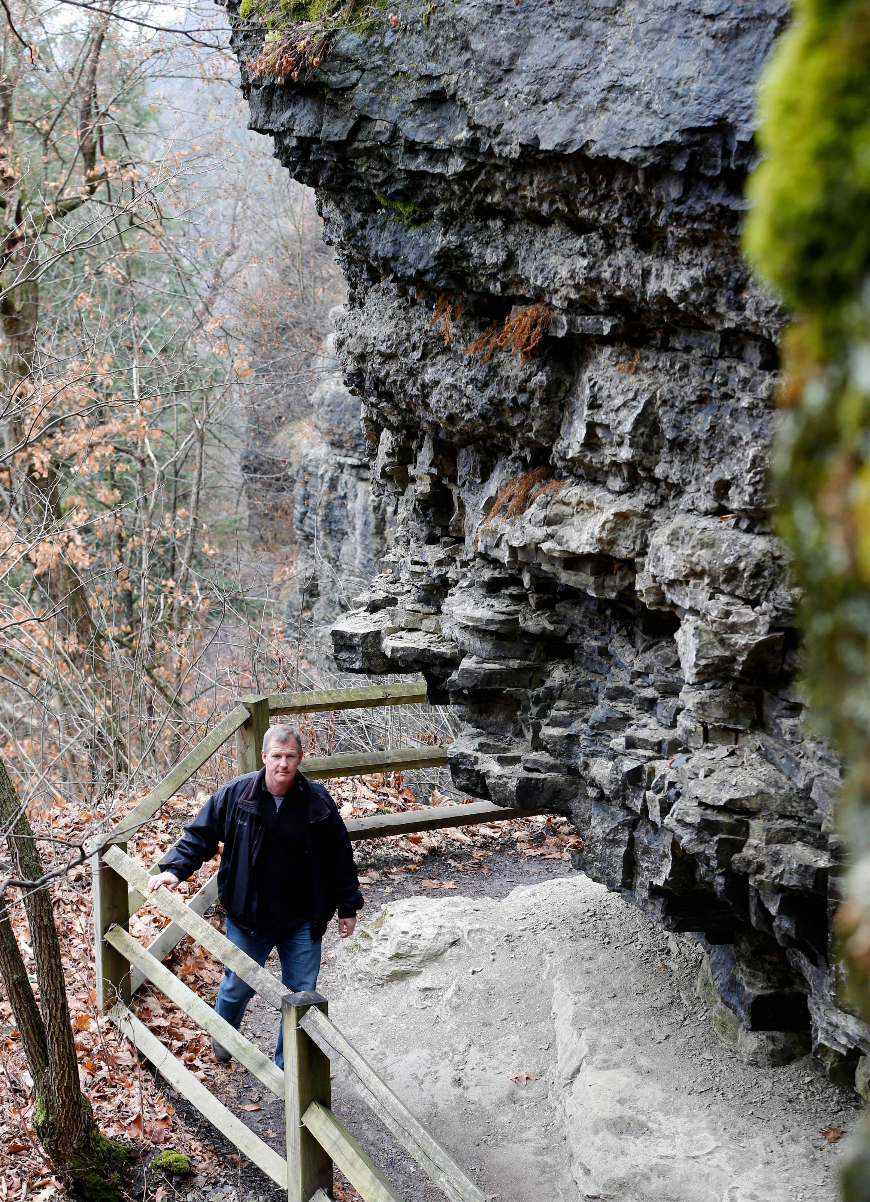 Chris Fallon, manager at John Boyd Thacher State Park, walks along the Indian Ladder trail in Guilderland, N.Y.