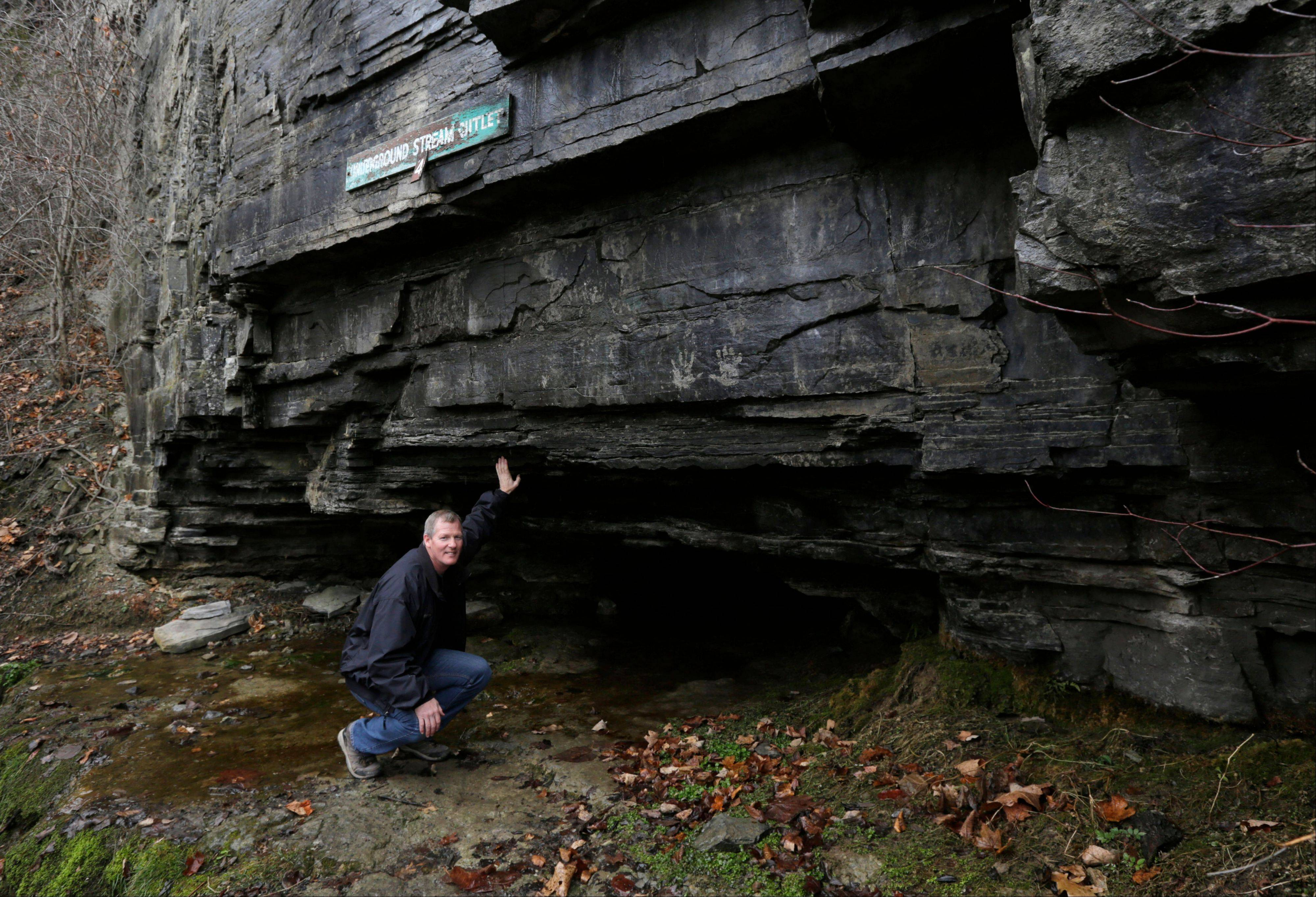 Chris Fallon, manager at John Boyd Thacher State Park, shows the entrance to Fool's Crawl Cave in Guilderland, N.Y.
