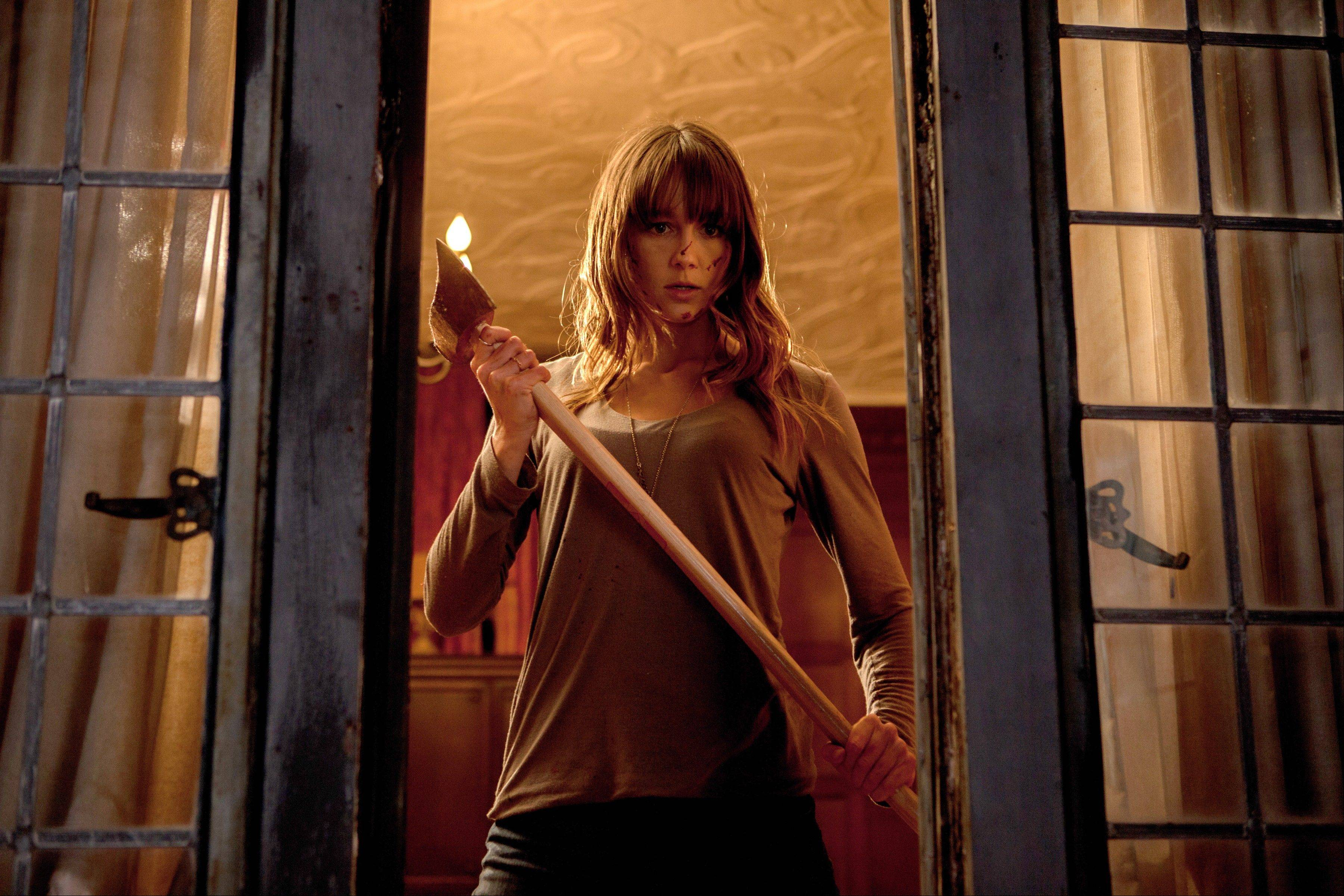 "Sharni Vinson stars as the guest at a family reunion who springs into action when masked assailants strike in ""You're Next."""