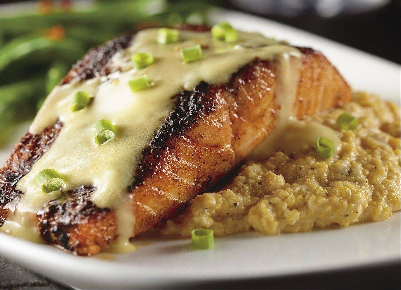 The blackened salmon comes on a bed of cheddar grits.