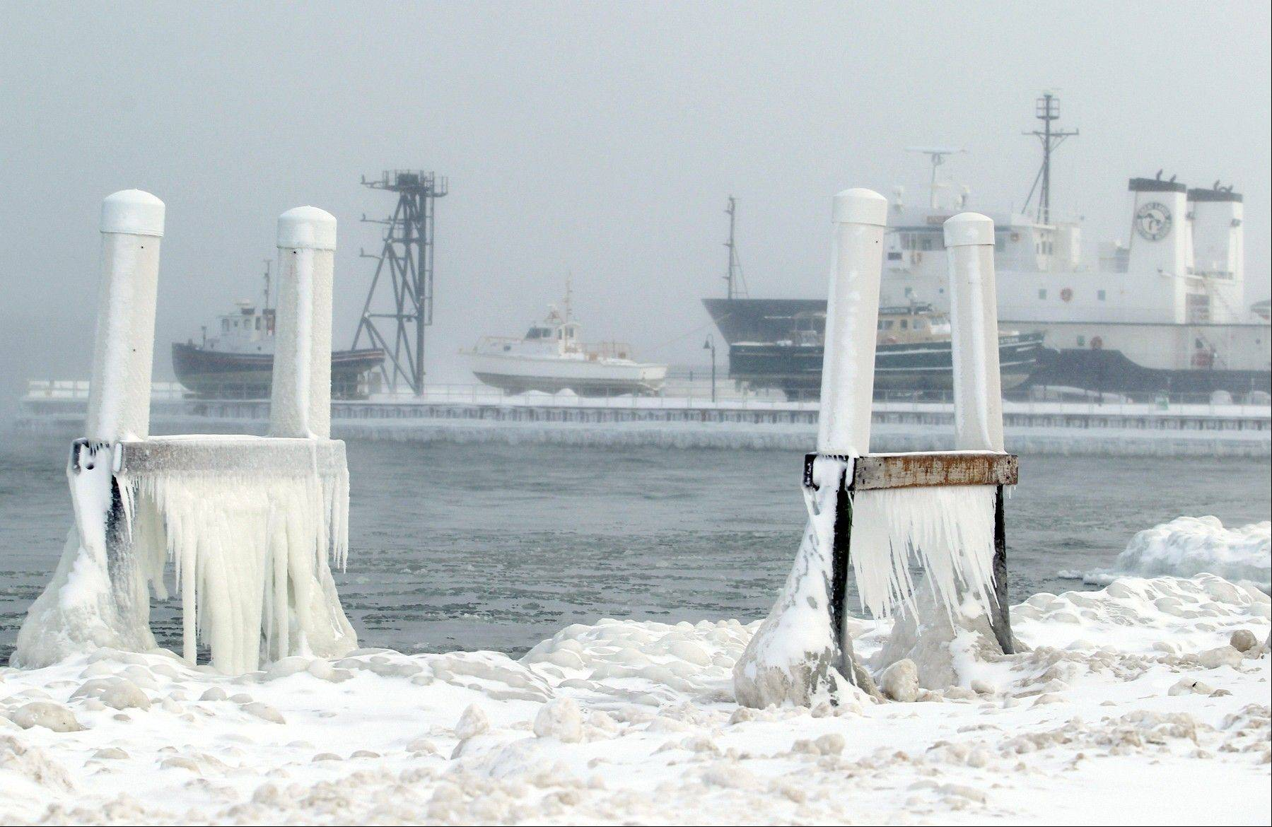 Ice forms on parts of a dock on West Grand Traverse Bay near the Great Lakes Maritime Academy in Traverse City, Mich., earlier this week.