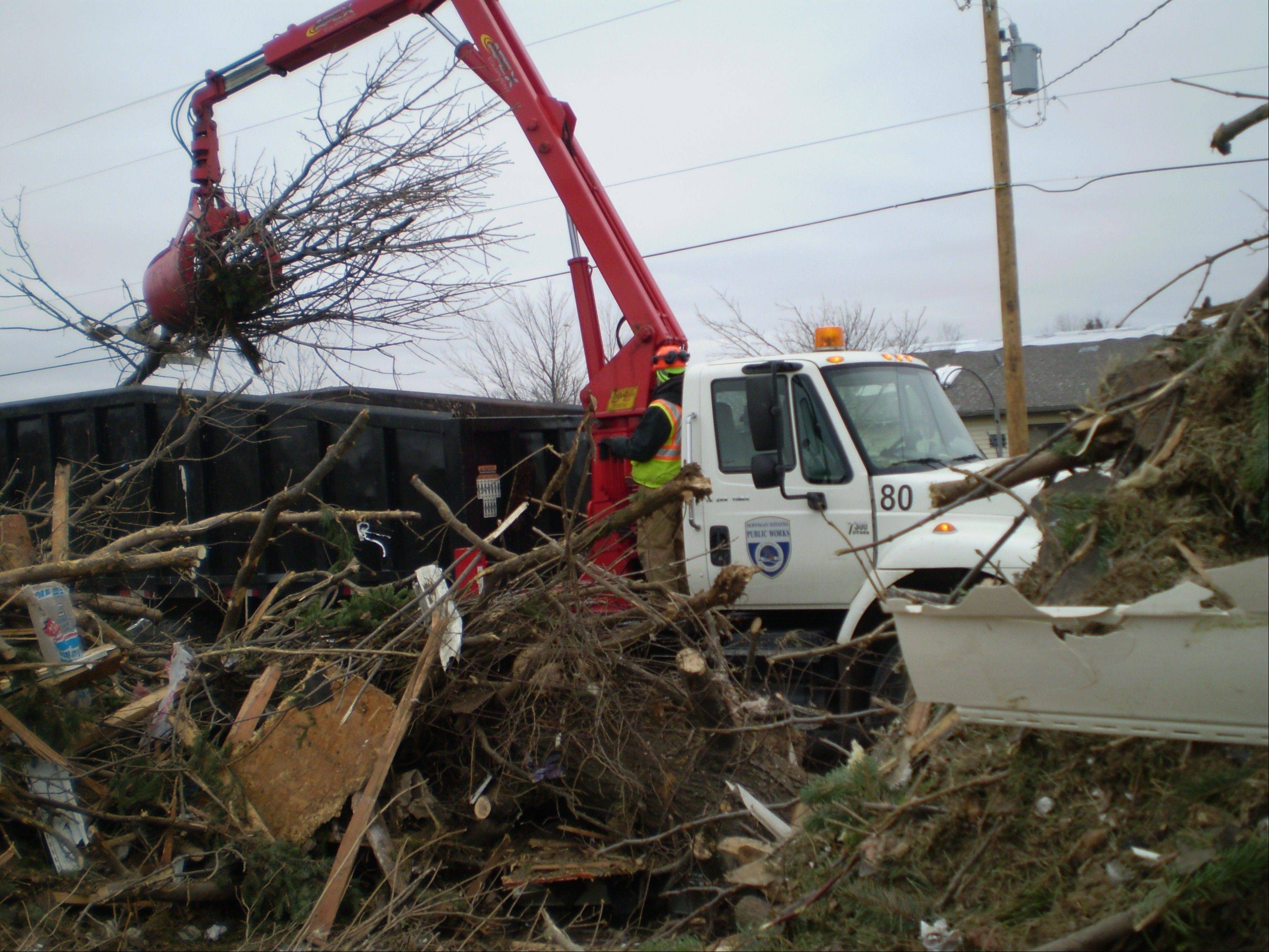 Hoffman Estates employees used a grapple truck the village recently purchased to help in tornado cleanup in Washington, Ill.