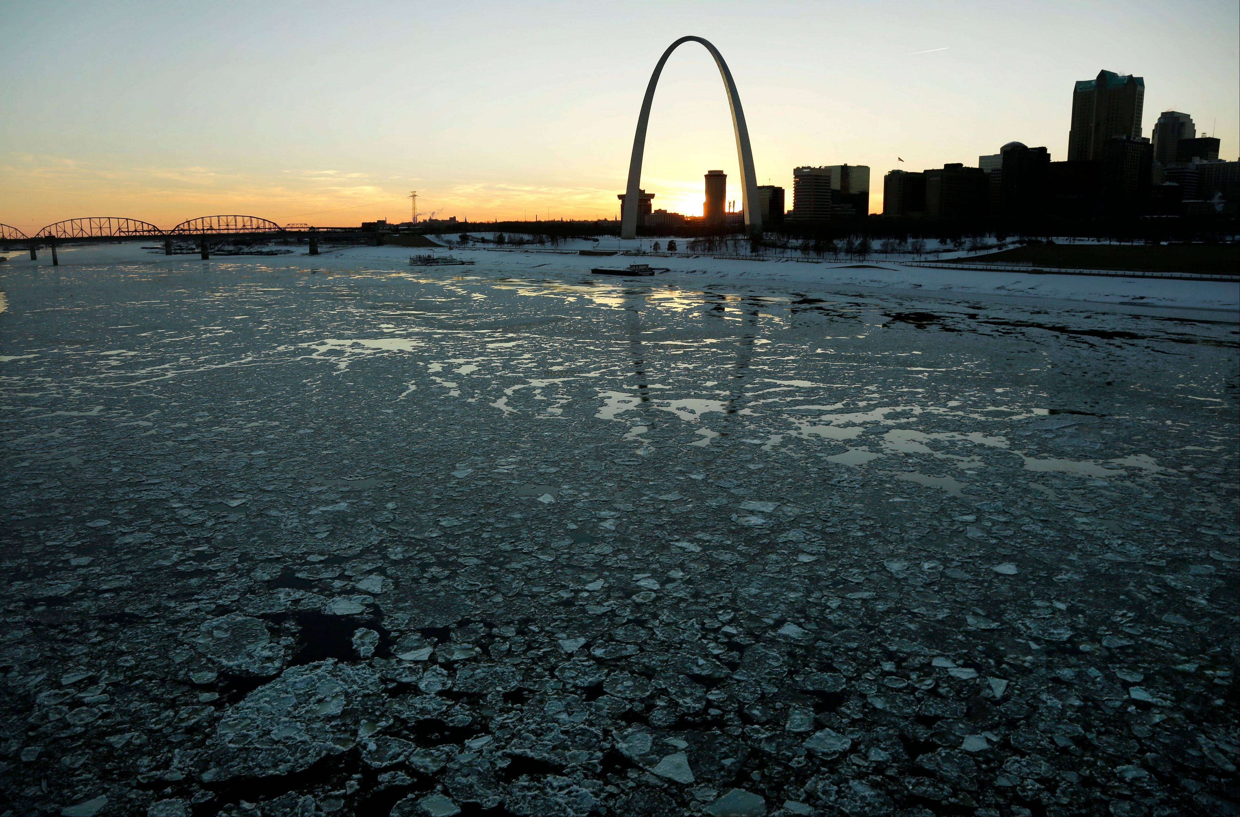 Ice in the Mississippi River flows past the Gateway Arch Tuesday, Jan. 7, 2014, in St. Louis.