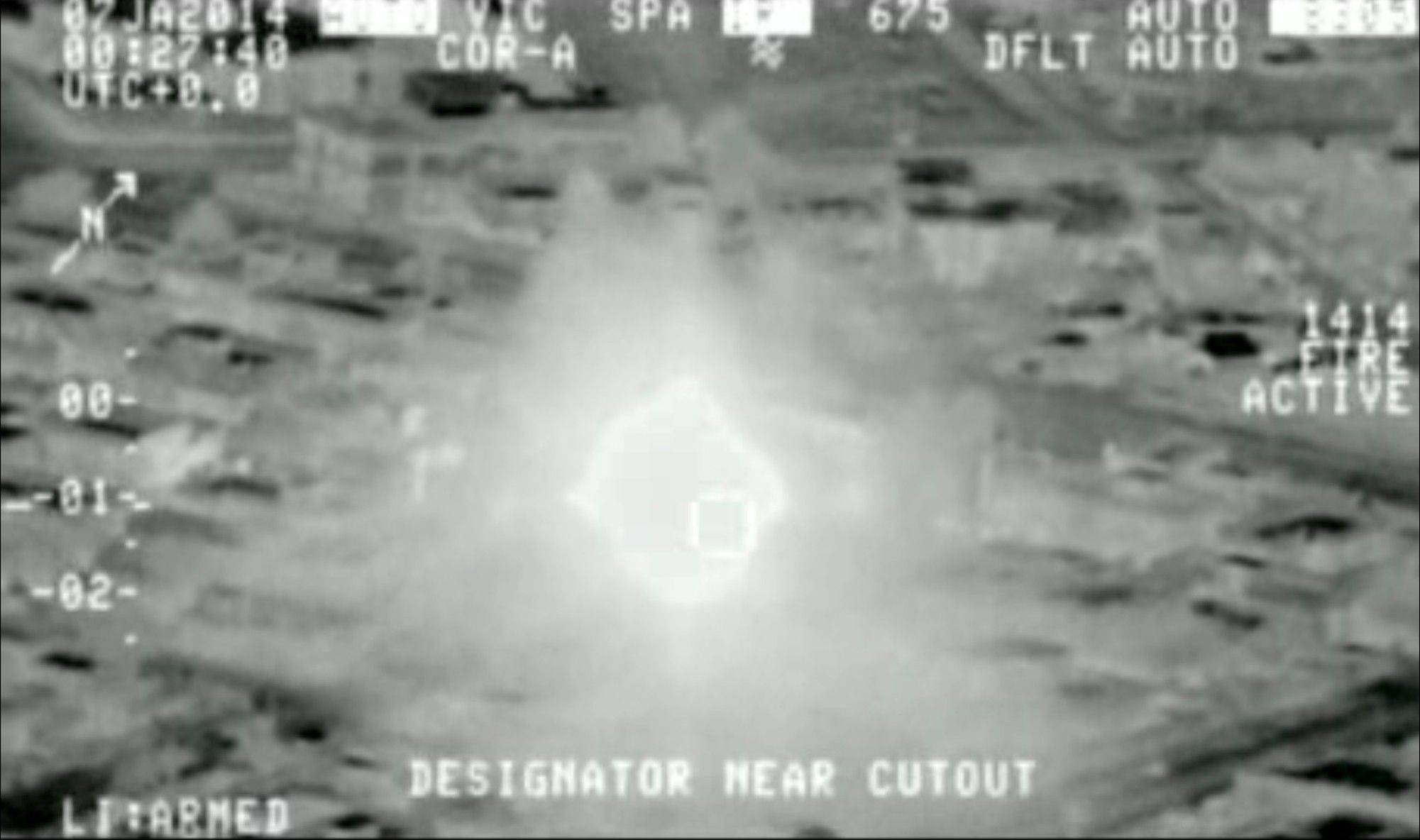 This Jan. 7, 2014, photo from aerial video provided by the Iraq Defence Ministry, but which the authenticity of cannot be independently verified by The Associated Press, shows an ammunition dump on fire after being hit by an airstrike, in Anbar Province, Iraq.