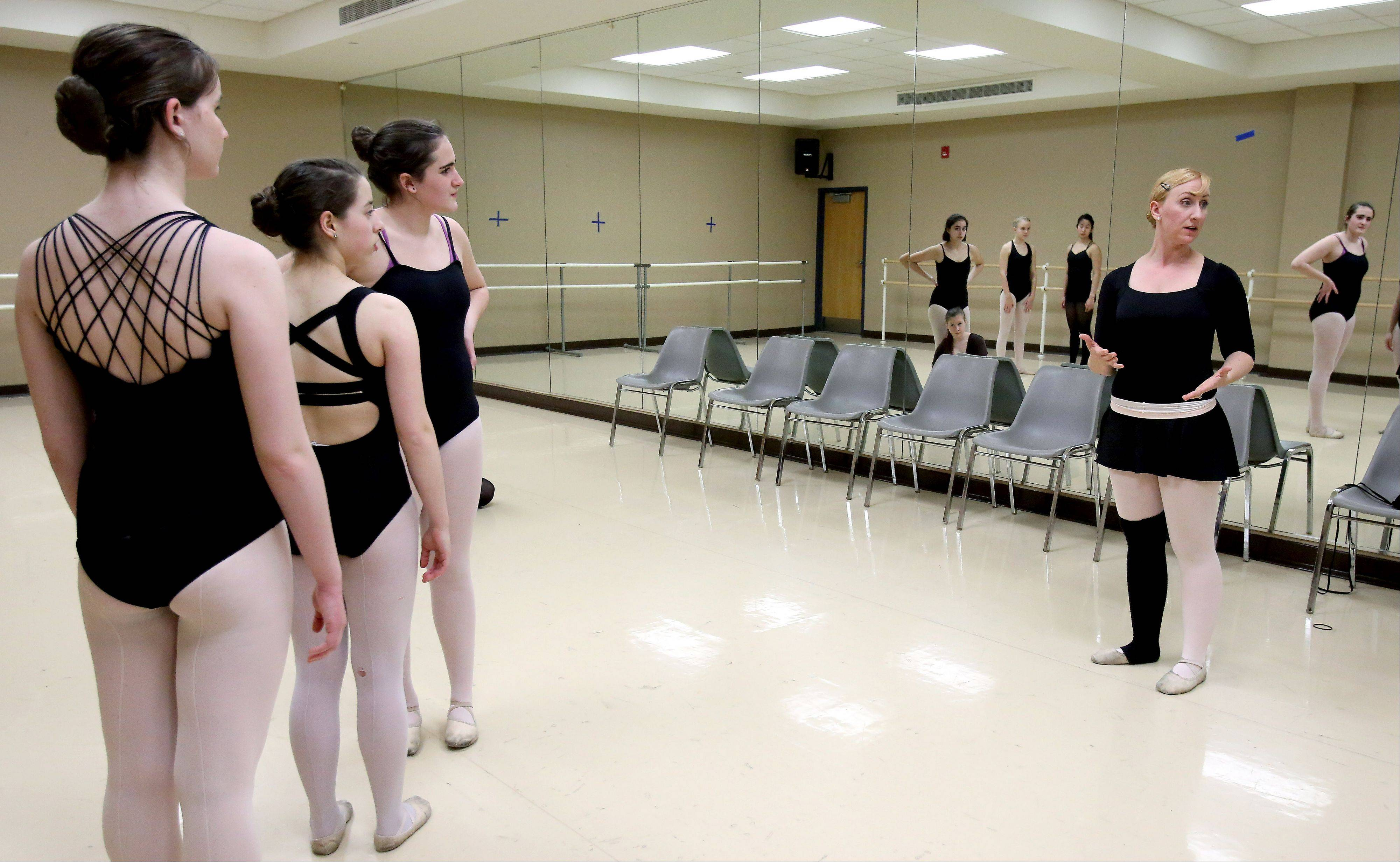Melissa Sall�e, right, a choreographer and teacher with Naperville Park District's Dance Academy, says she fell in love with ballet the first time she took a class. In add