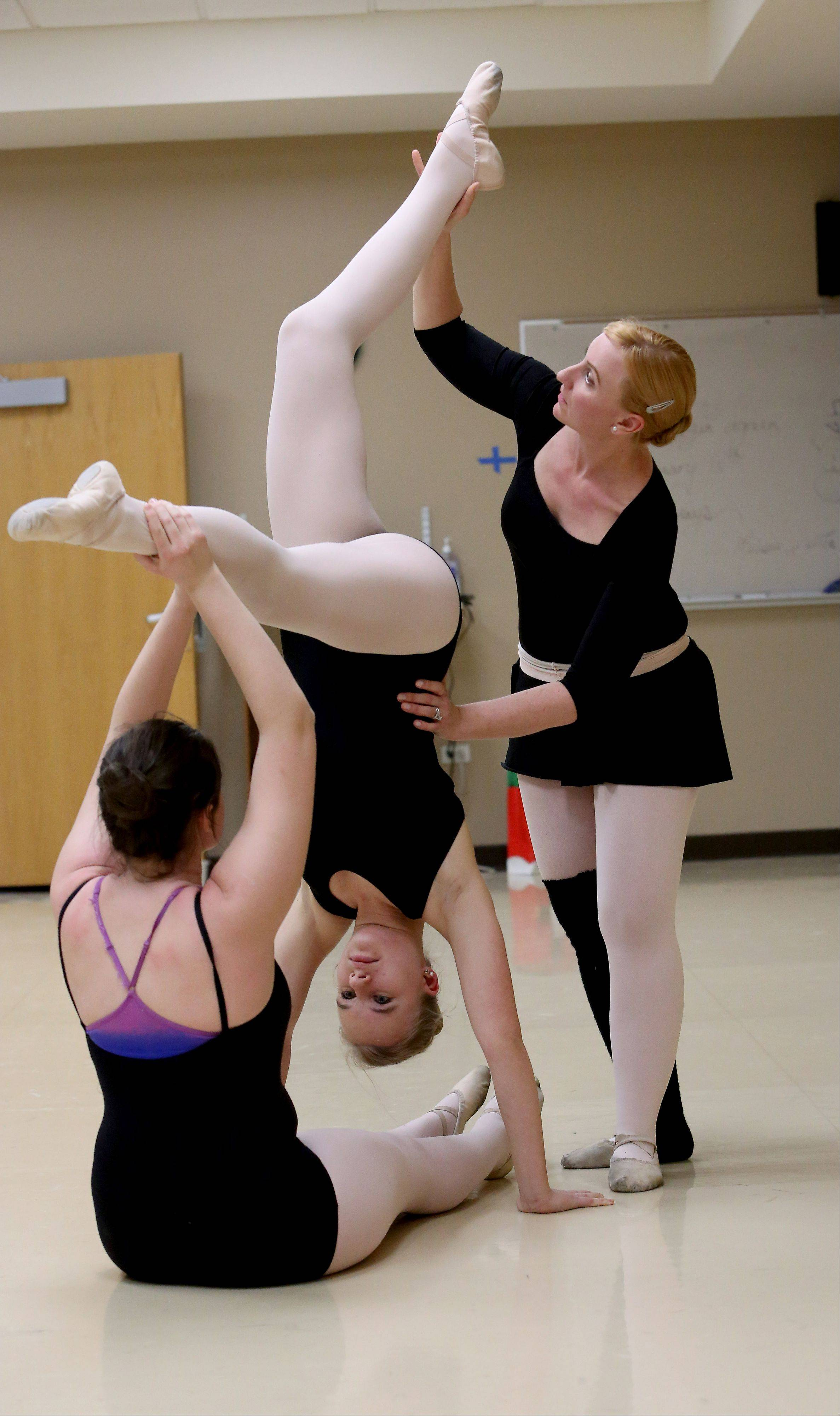Melissa Sall�e, a choreographer and teacher with Naperville Park District's Dance Academy, works with lifts with Hannah Micheau, 15, left, and Julia Waterbury, 16.