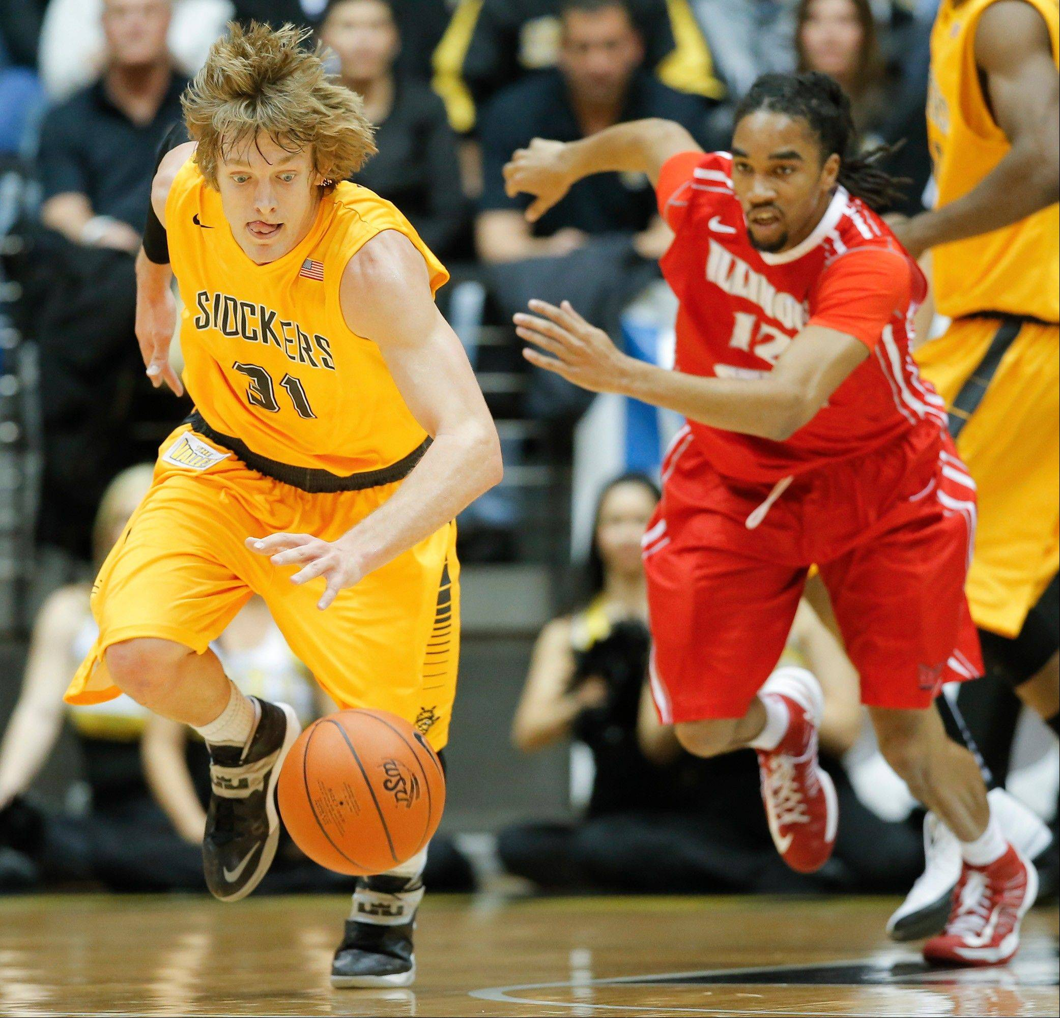 Wichita State's Ron Baker, left, steals the ball from Illinois State's Tony Wills during the first half of an NCAA college basketball game in Wichita, Kan., Wednesday, Jan. 8, 2014. (AP Photo/The Wichita Eagle, Travis Heying) LOCAL TV OUT; MAGAZINES OUT; LOCAL RADIO OUT; LOCAL INTERNET OUT