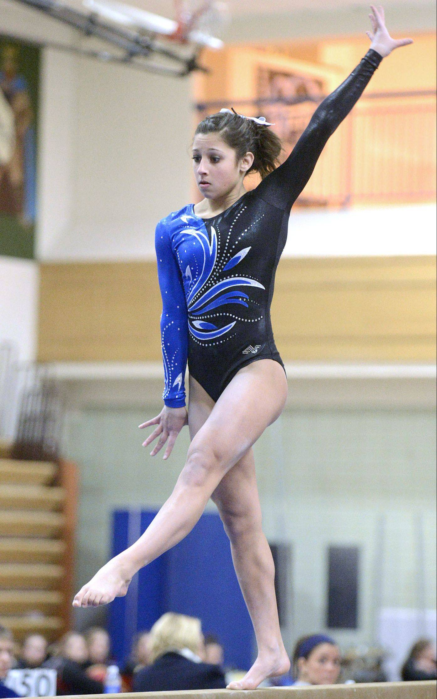 Geneva's Claire Ginsberg competes on the beam Wednesday.