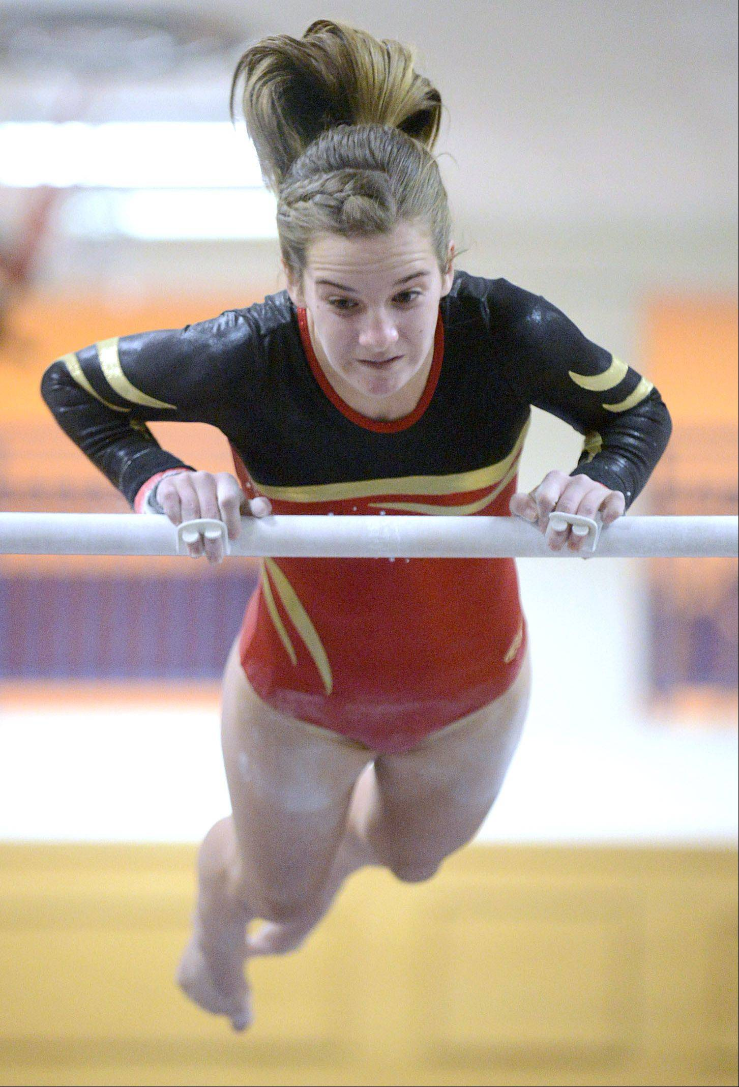 Batavia's Cameron Hindel competes on the uneven bars during the gymnastics meet vs. Geneva on Wednesday, January 8.