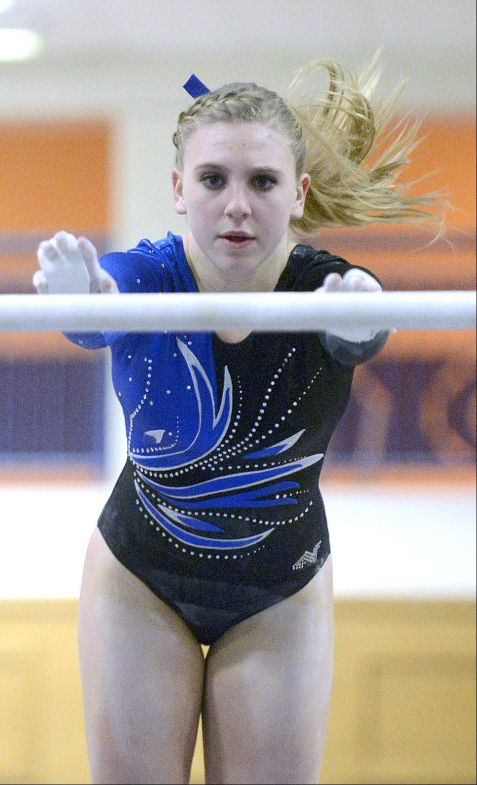 Geneva's Megan Beitzel completes on the uneven bars during the gymnastics meet vs. Batavia on Wednesday, January 8.