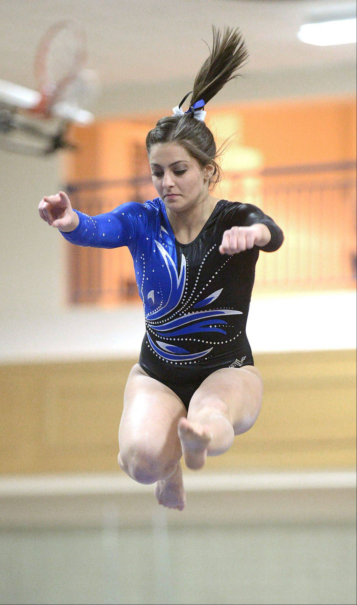 Geneva's Dominique Brognia competes on the beam during the gymnastics meet vs. Batavia on Wednesday, January 8.