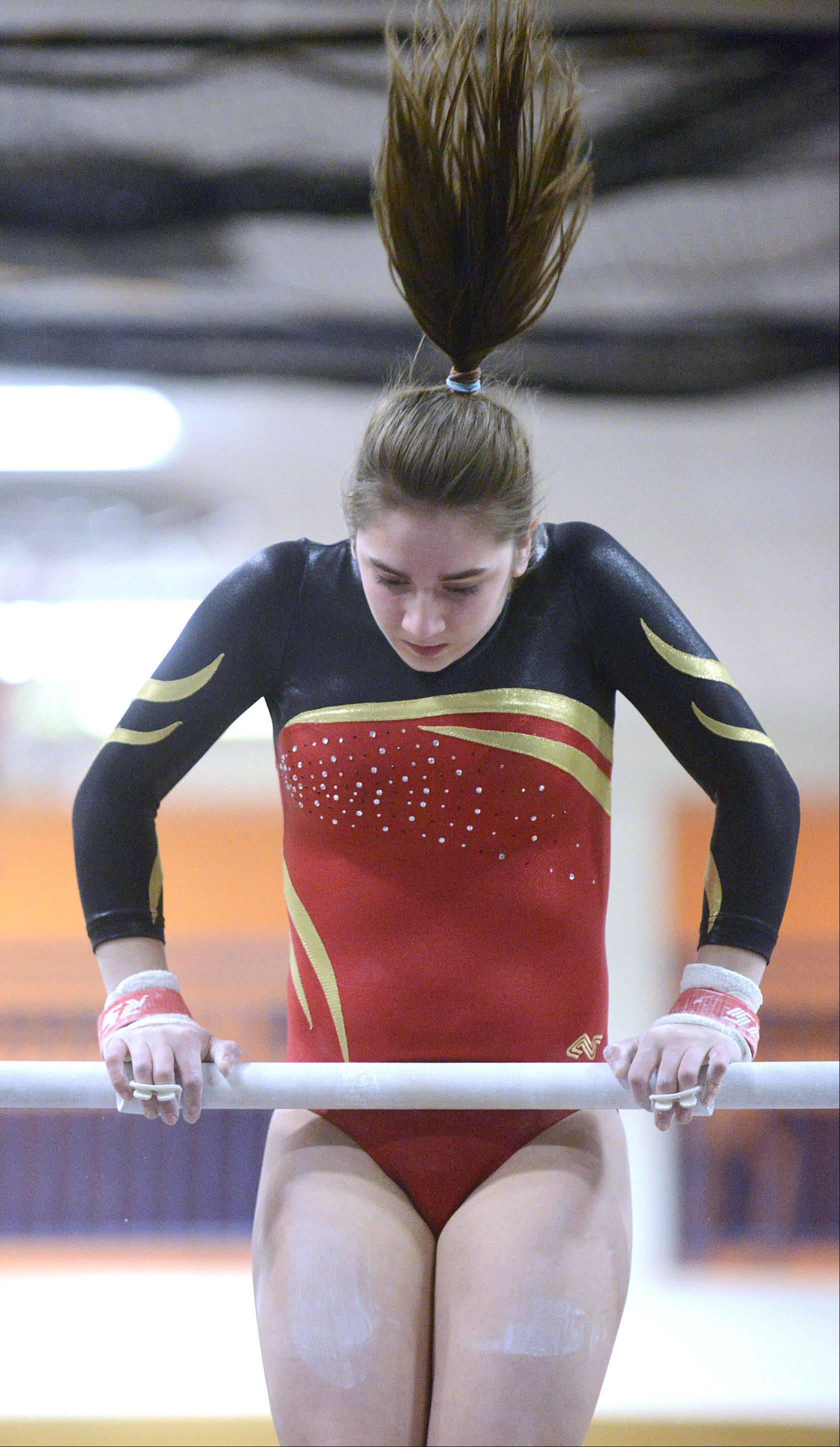 Batavia's Megan McGee competes on the uneven bars during the gymnastics meet vs. Geneva on Wednesday, January 8.
