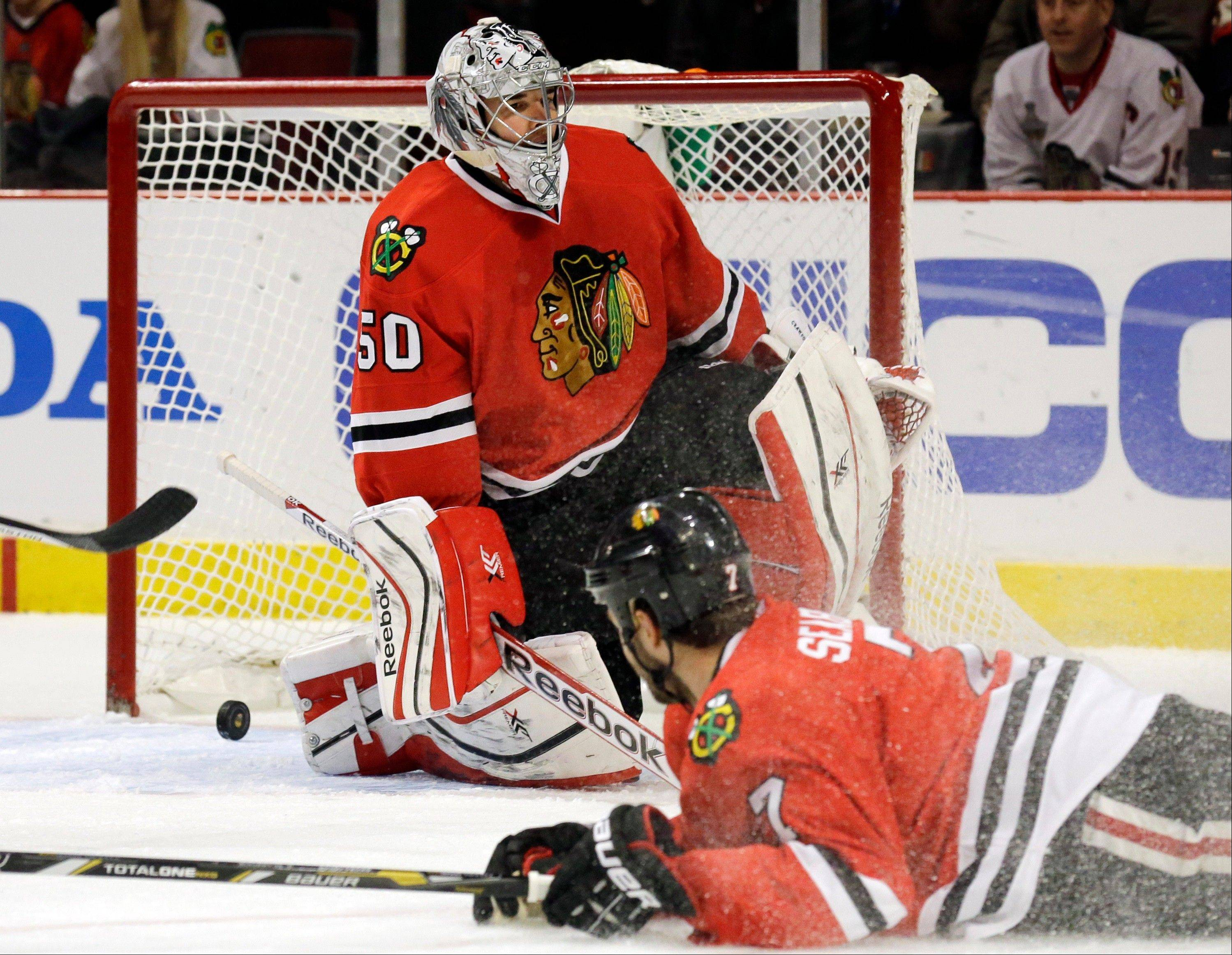Chicago Blackhawks goalie Corey Crawford (50) reacts after New York Rangers' Brad Richards (not shown) scored a goal during the first period of an NHL hockey game in Chicago, Wednesday, Jan. 8, 2014.
