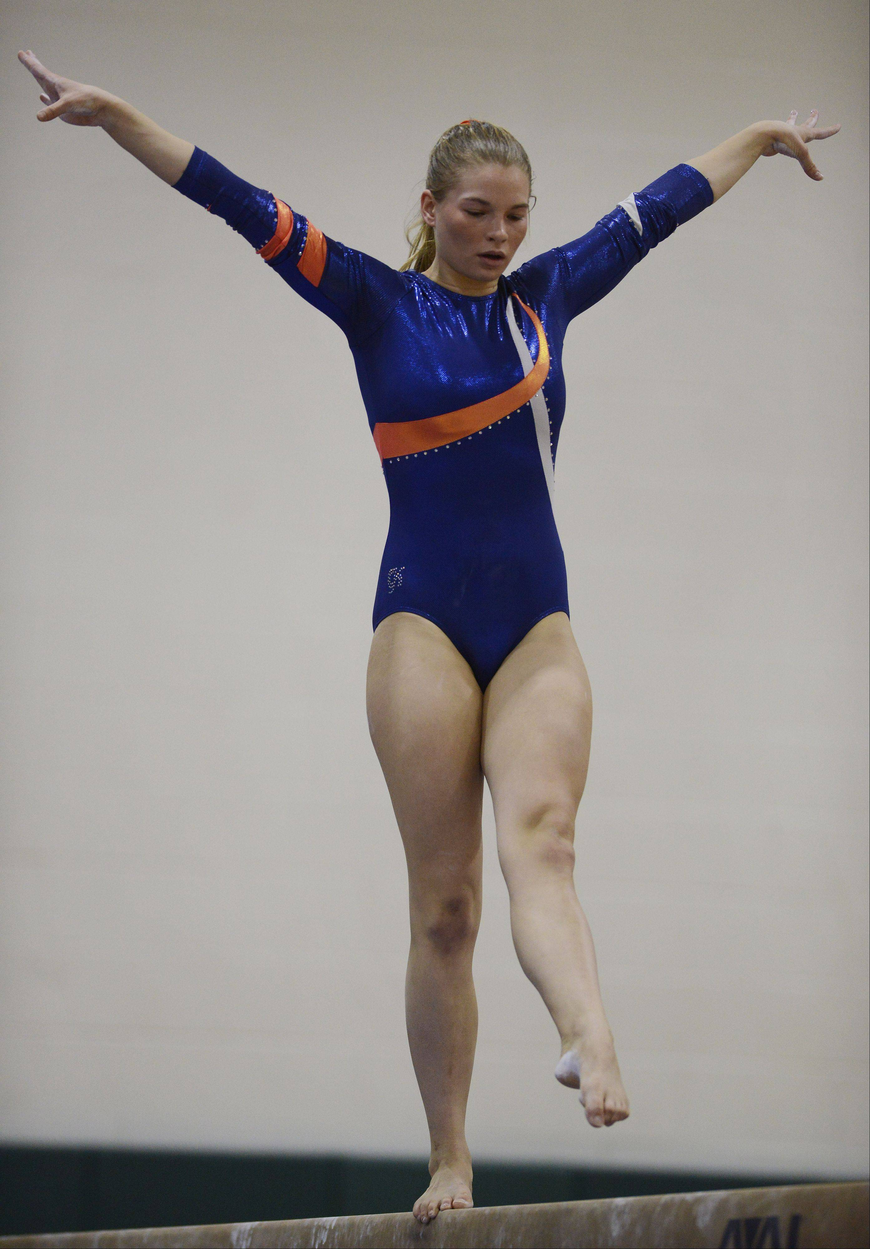 Buffalo Grove's Erika Ray competes on the balance beam during Wednesday's meet with Hersey and Fremd.